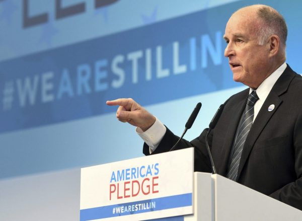 """California governor Jerry Brown speaking in the tent of the climate initiative """"America's Pledge"""" during the World Climate Conference this week in Bonn, Germany. Photo by Henning Kaiser via AP Images."""