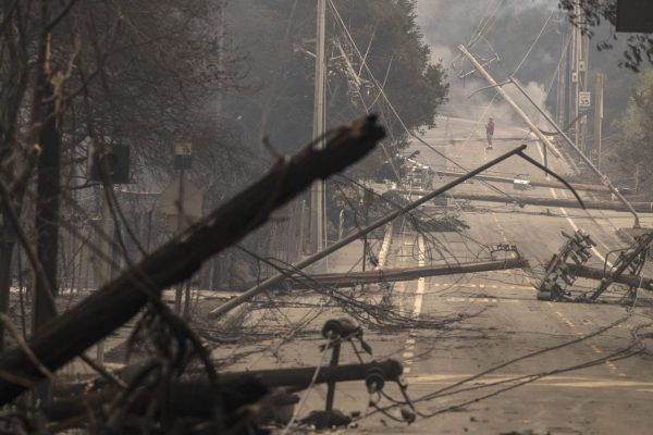 ANTA ROSA, CA -- MONDAY, OCTOBER 9, 2017: Power poles and lines block a street at Brookdale and Aaron Dr. in Hidden Valley where most of the homes were destroyed by fire in Santa Rosa, CA, on Oct. 9, 2017. (Brian van der Brug / Los Angeles Times)