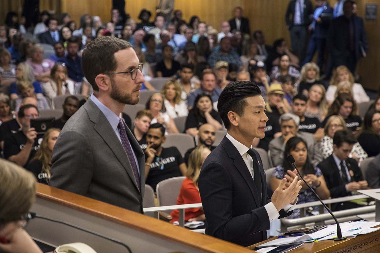 "State Sen. Scott Wiener of San Francisco and Assemblyman Evan Low of Campbell argue for a bill banning the advertising or sale of ""gay conversion therapy"" in 2018. Photo by Robbie Short for CALmatters"