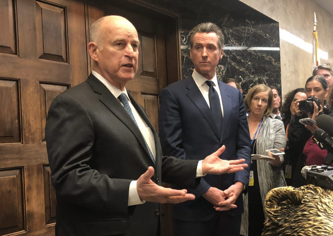 Gov. Jerry Brown and Gov.-elect Gavin Newsom address the Capitol press on Nov. 13, 2018, in the aftermath of the devastating Camp and Woolsey Fires. Photo for CALmatters by Byrhonda Lyons.
