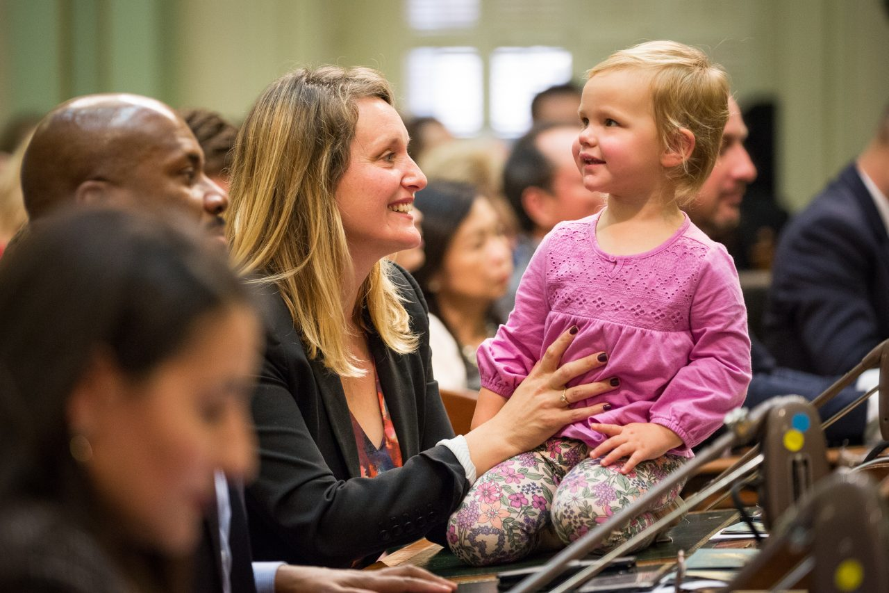 Democrat Assemblymember Buffy Wicks, left, plays with her two-year-old daughter, Josephine Ambler, on her desk after being sworn into the California Assembly, December 3, 2018 at the State Capitol in Sacramento, California.