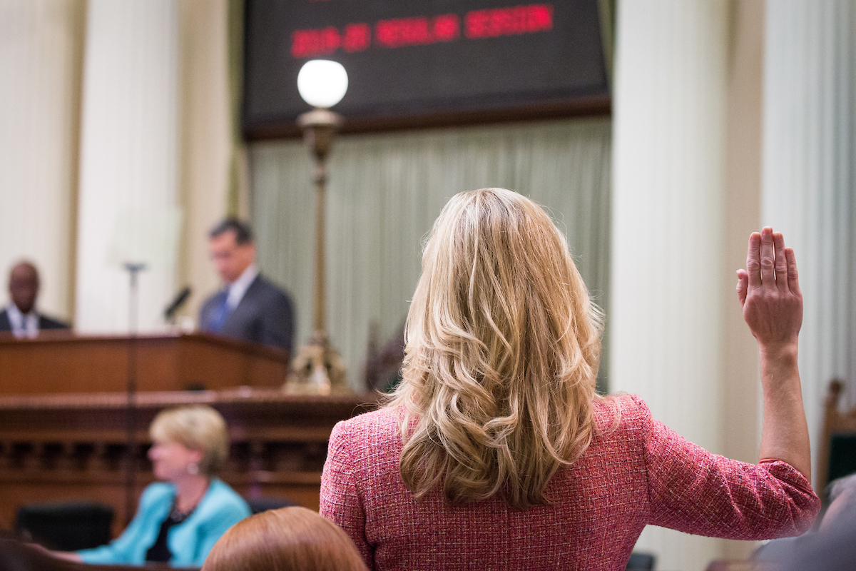 Assemblymember Christy Smith is sworn in on the floor of the Assembly chambers. Photo by Max Whittaker for CALmatters