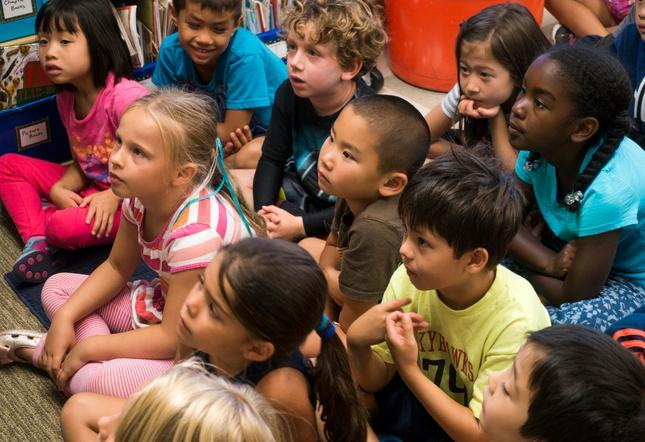 Students listen during their first grade class as teacher Caroline Archibald teaches their social emotinal learning lesson for the day at Redwood Shores Elementary School in Redwood City, Calif., on Thursday, Sept. 3, 2015. (John Green/Bay Area News Group)
