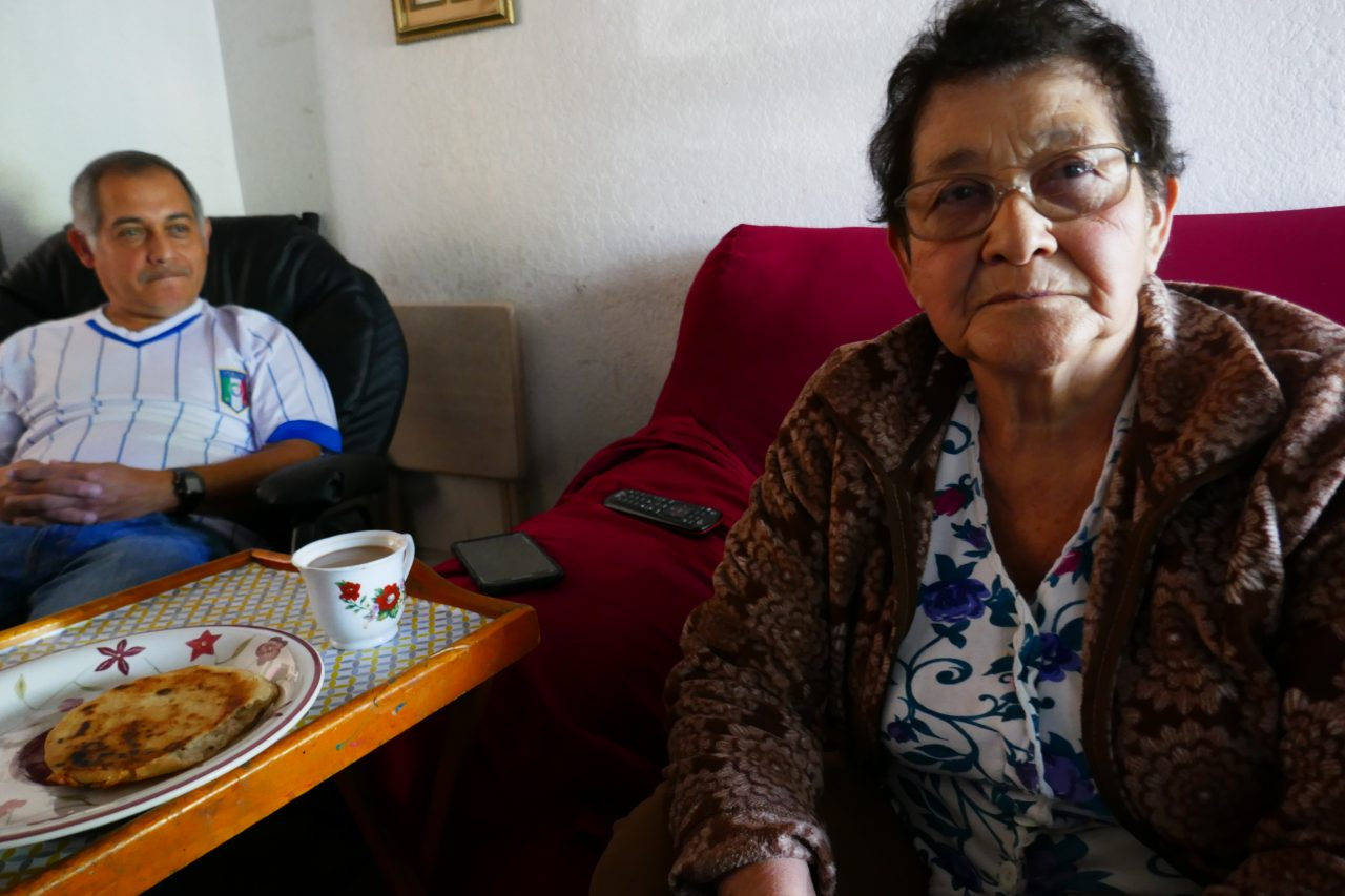 Cruz Cubias Castillo, 77, lives with her son Alejandro Cubias and his family. The only money she earns is from recycling cans and bottles. The green card holder qualifies for food assistance but won't apply for it because she fears that could hurt her or her family later. Photo by Elizabeth Aguilera for CALmatters