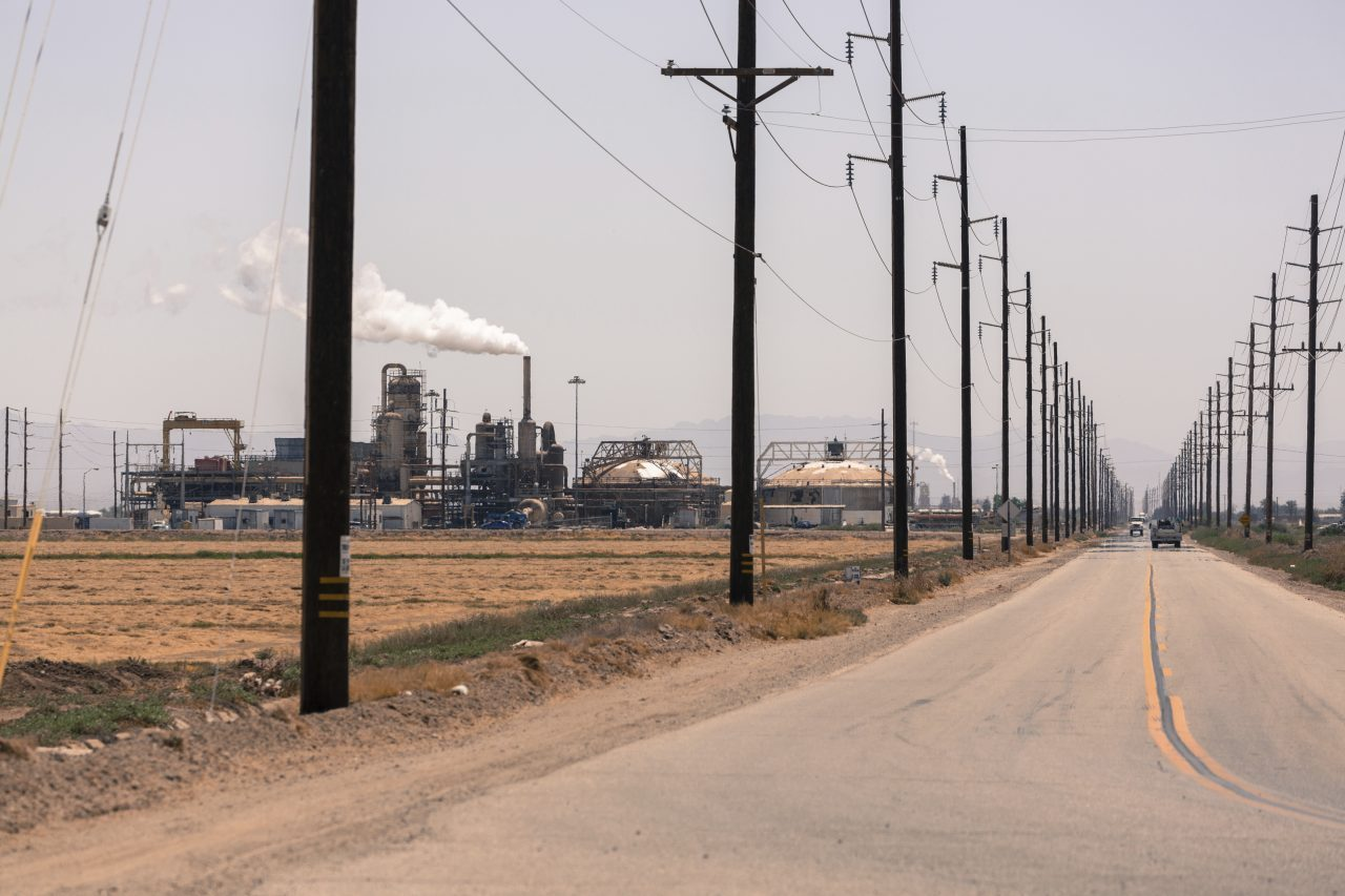 Agriculture in the Imperial Valley—an area known for high asthma rates and high level of air pollution. )The geothermal plant in the background releases steam and is not a culprit.) Photo by Olivier Hertel/Abaca/Sipa USA(Sipa via AP Images)