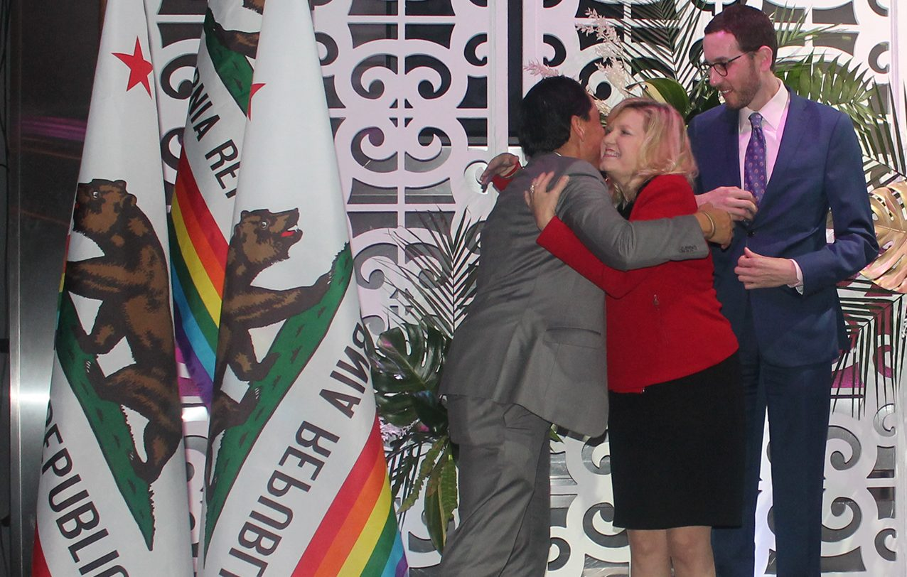 From left to right: California Legislative LGBT Caucus members Assemblyman Todd Gloria of San Diego and Sens. Cathleen Galgiani of Stockton and Scott Wiener of San Francisco celebrate at an Equality California event in January. Photo by Elizabeth Castillo for CALmatters