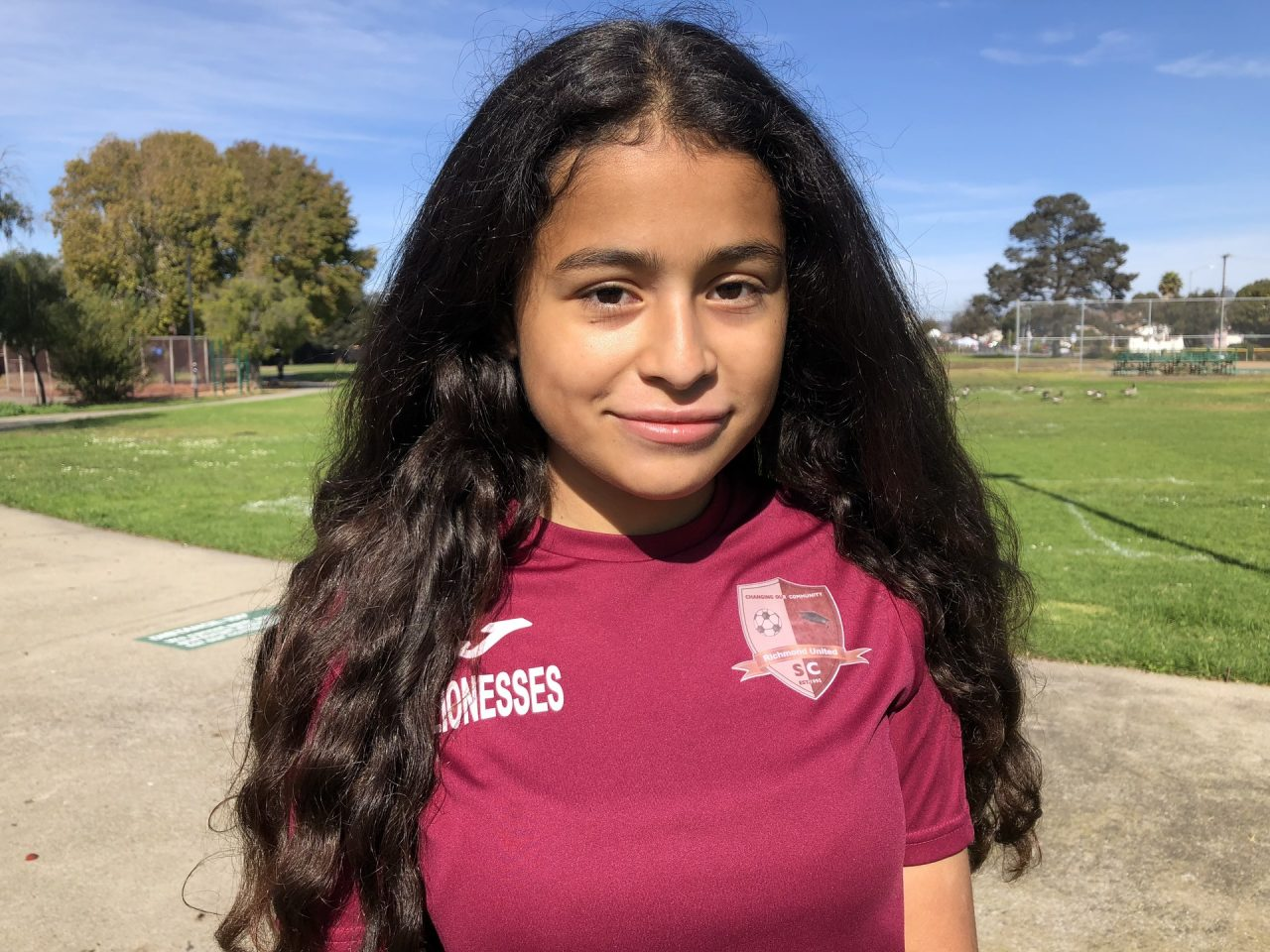 """Crista Ramos, 14, stands at a park in Richmond after a soccer match on Nov. 4, 2018. """"I felt like I needed to speak up... and represent all the children whose parents have TPS and could be sent back,"""" said Crista of why she is suing the federal government. Photo for CALmatters by Farida Jhabvala Romero/KQED"""