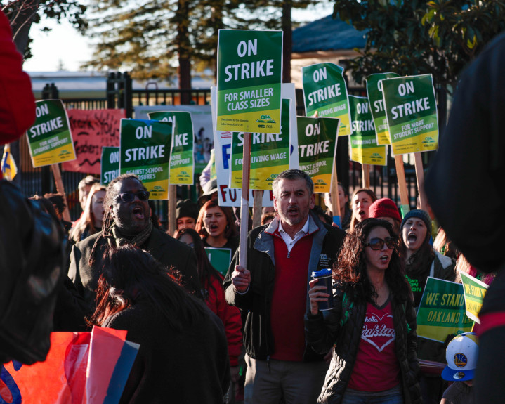Teachers and supporters picket outside of Manzanita School in Oakland, Calif., on Thursday, Feb. 21, 2019. Oakland educators are seeking better wages and resources for their schools. (Randy Vazquez/Bay Area News Group)