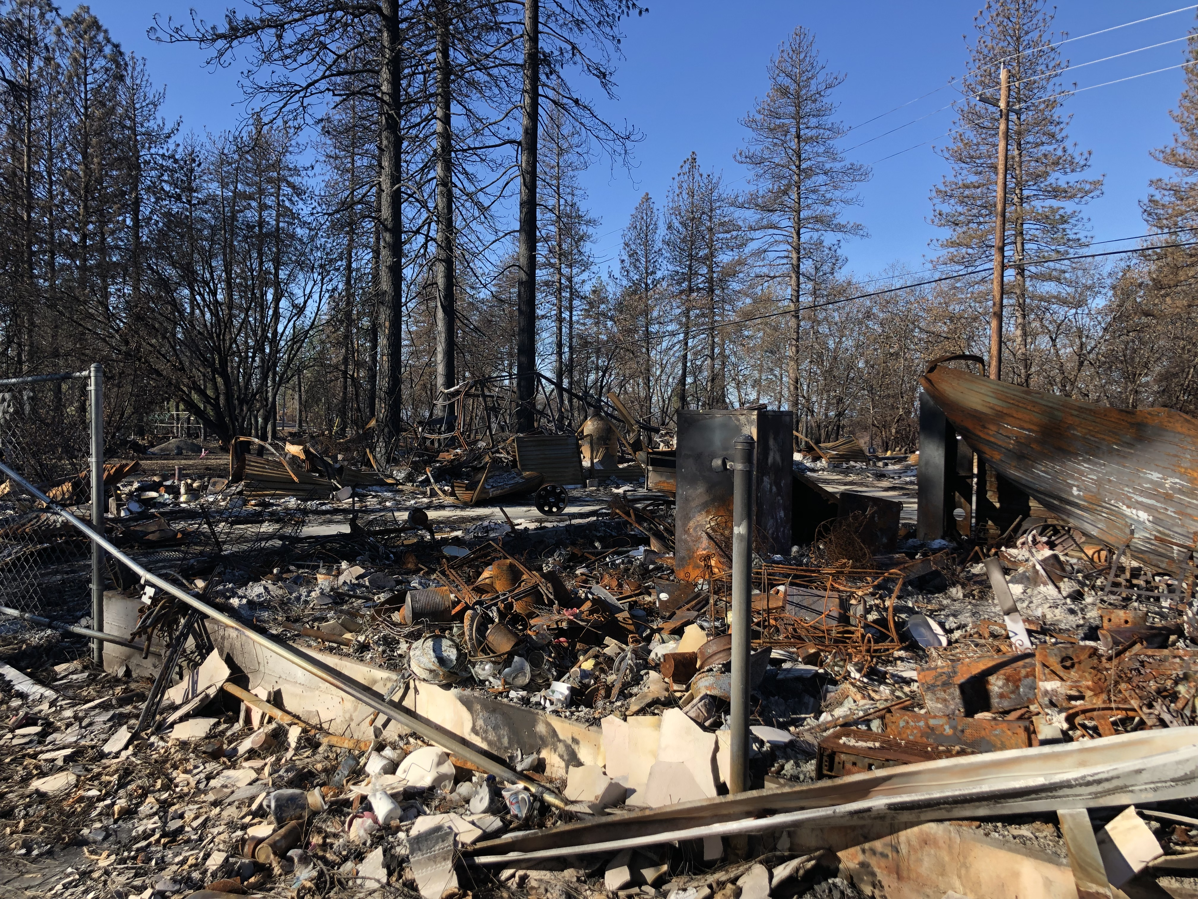 Scenic shot of burned items from the 2018 Camp Fire in Paradise, California. March 2019. Photo by Byrhonda Lyons/CALmatters.