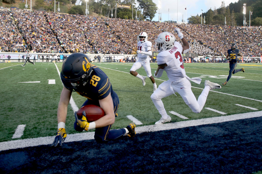 BERKELEY, CALIFORNIA - DECEMBER 1: California Golden Bears running back Patrick Laird (28) is pushed out of bounds by Stanford Cardinal safety Malik Antoine (3) during the first half of the Big Game at the Memorial Stadium in Berkeley, Calif., on Saturday, Dec. 1, 2018. (Ray Chavez/Bay Area News Group)