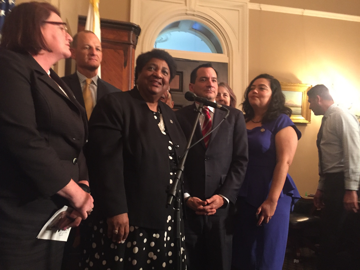 Assemblywoman Shirley Weber, a Democrat from San Diego, speaks as a press conference flanked by Sen. Toni Atkins and Speaker Anthony Rendon after the passage of AB392.