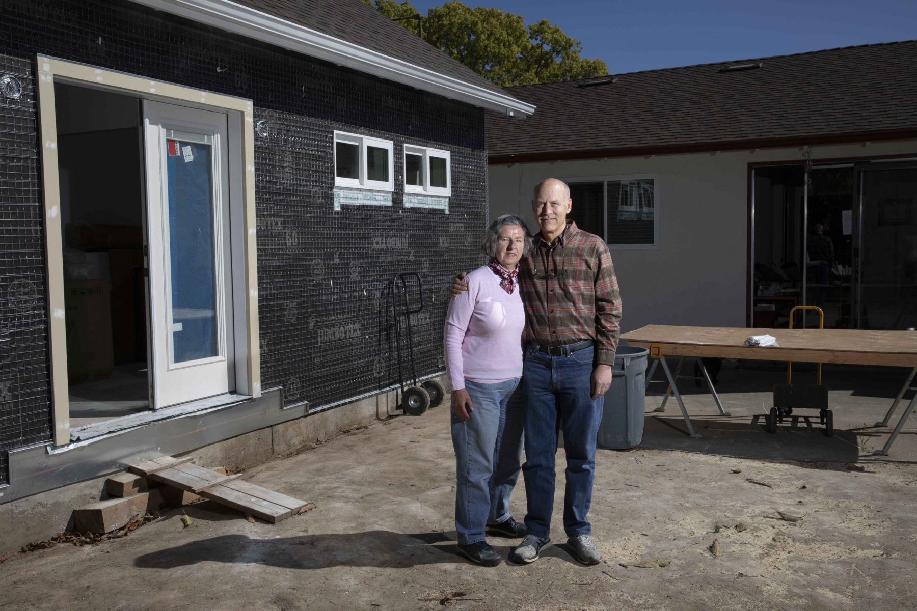 Paul and Rosa Boehm outside the Accessory Dwelling Unit they're building in the backyard of their west San Jose home. Paul and Rosa are considering downsizing into the ADU. Photo by Sean Havey for California Dream project