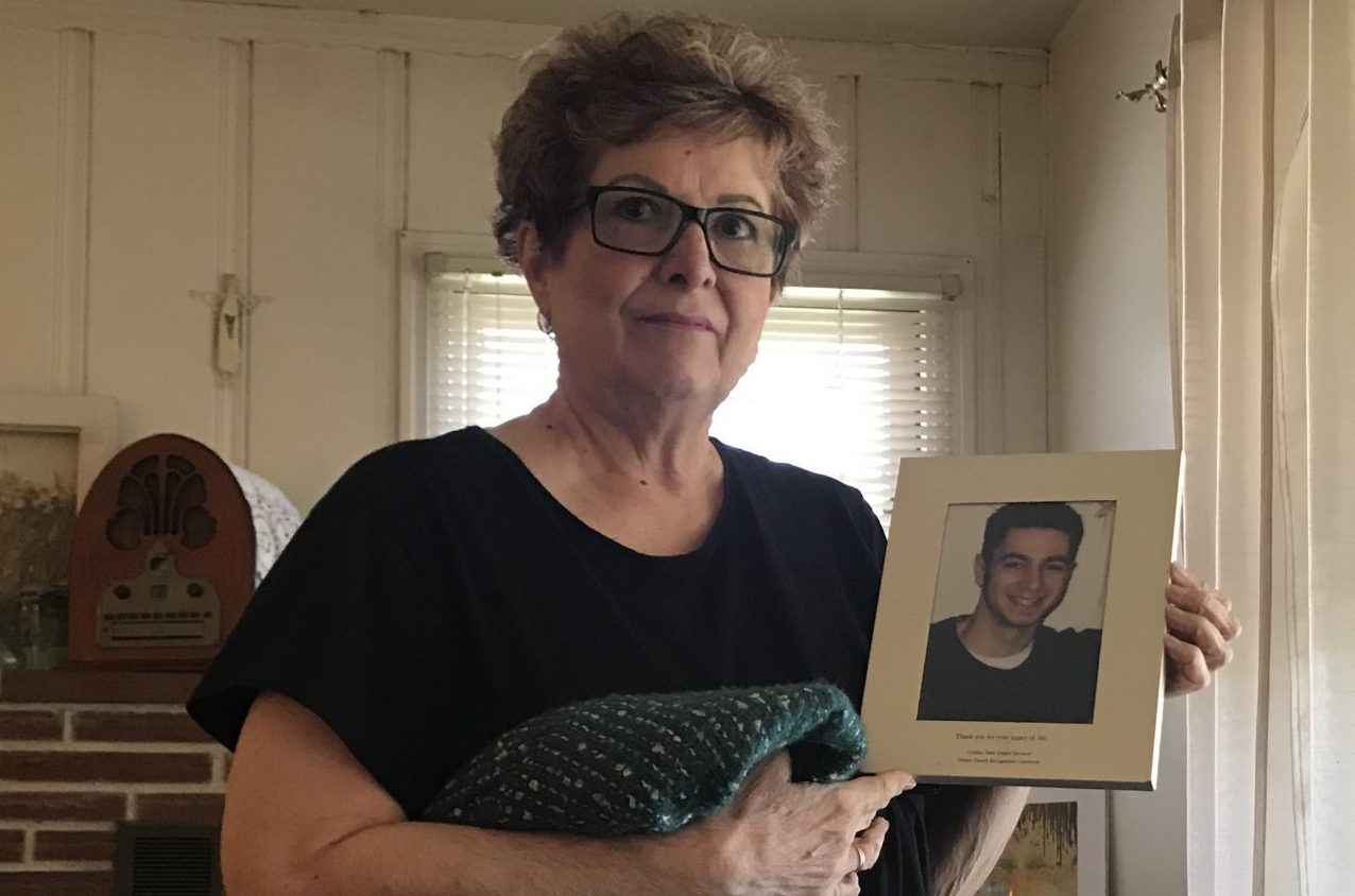 Former Capitol staffer Stepheny Milo with a photo of her son, Matthew Sievert, who was ambushed and shot to death in 2003. Photo for CALmatters by Dan Morain