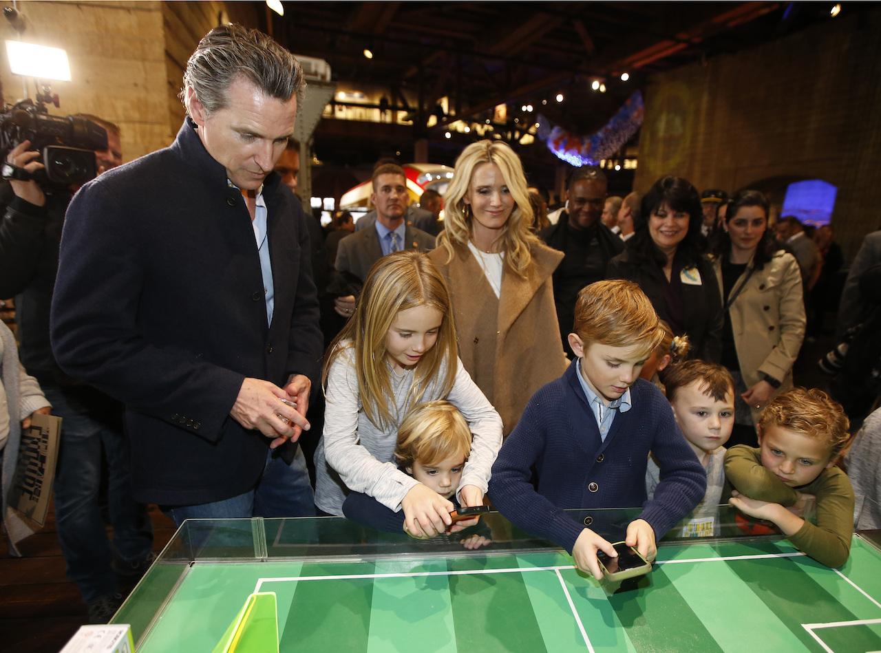photo of gavin newsom with his family