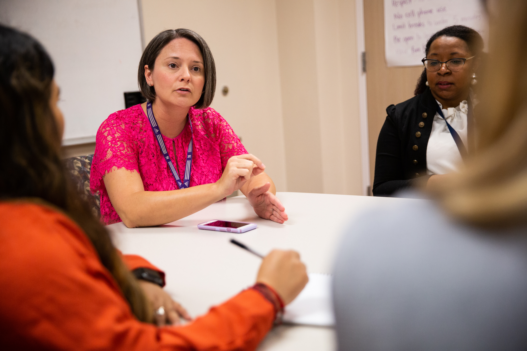 Tara Niendam, left, meets with staff at the UC Davis Behavioral Health Center in Sacramento. She is helping to lead efforts to expand early psychosis intervention programs statewide. Photo by Max Whittaker for CALmatters