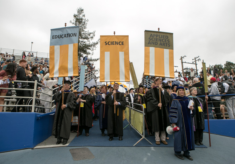 San Jose State University faculty enter Spartan Stadium during the processional at a commencement in San Jose. Photo by LiPo Ching, Bay Area News Group