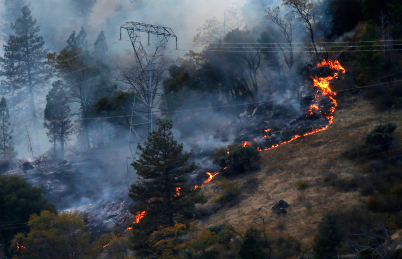 The deadly 2018 Camp Fire burns around PG&E transmission towers east of Pulga, near the source of the first report of the fire.