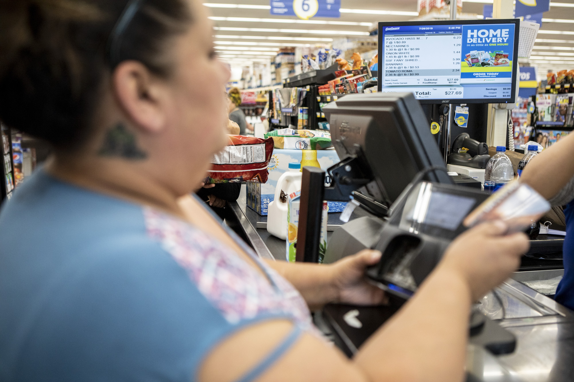 Antoinette Martinez uses CalFresh to pay for her groceries at FoodMaxx on July 26, 2019. The food she purchases today is expected to last her and her five-year-old for at least a week. Photo by Anne Wernikoff/CalMatters
