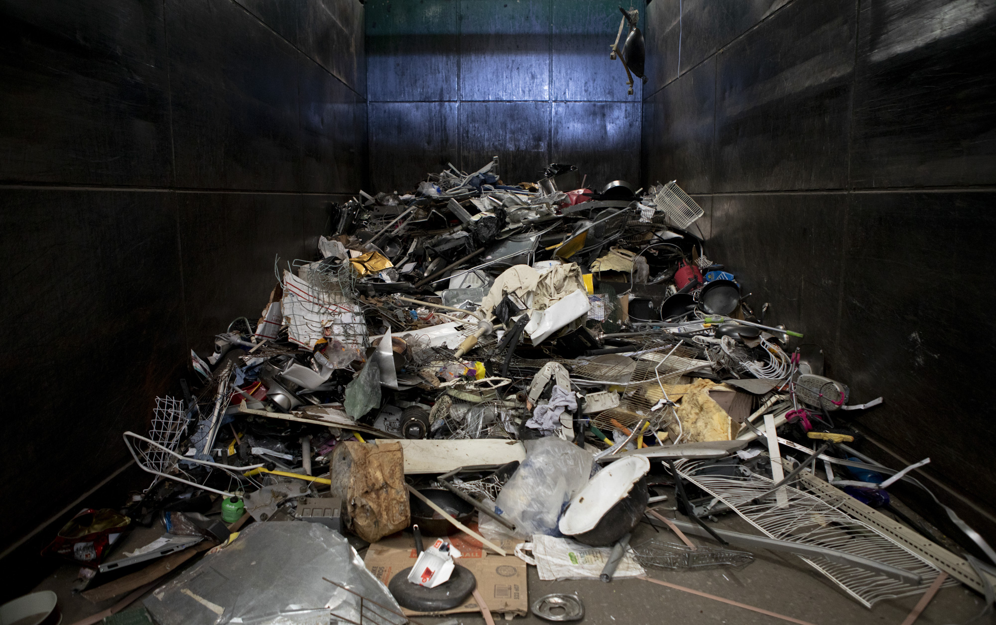 A large pile of metal that has been sorted out from paper and plastic at greenwaste on July 29, 2019. Photo by Anne Wernikoff/CalMatters