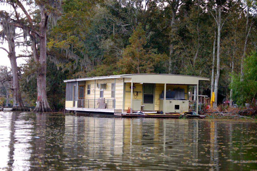 People who live in houses along Louisiana's bayous take their chances with the encroaching waters. Photo by J.C. Winkler via Flickr.
