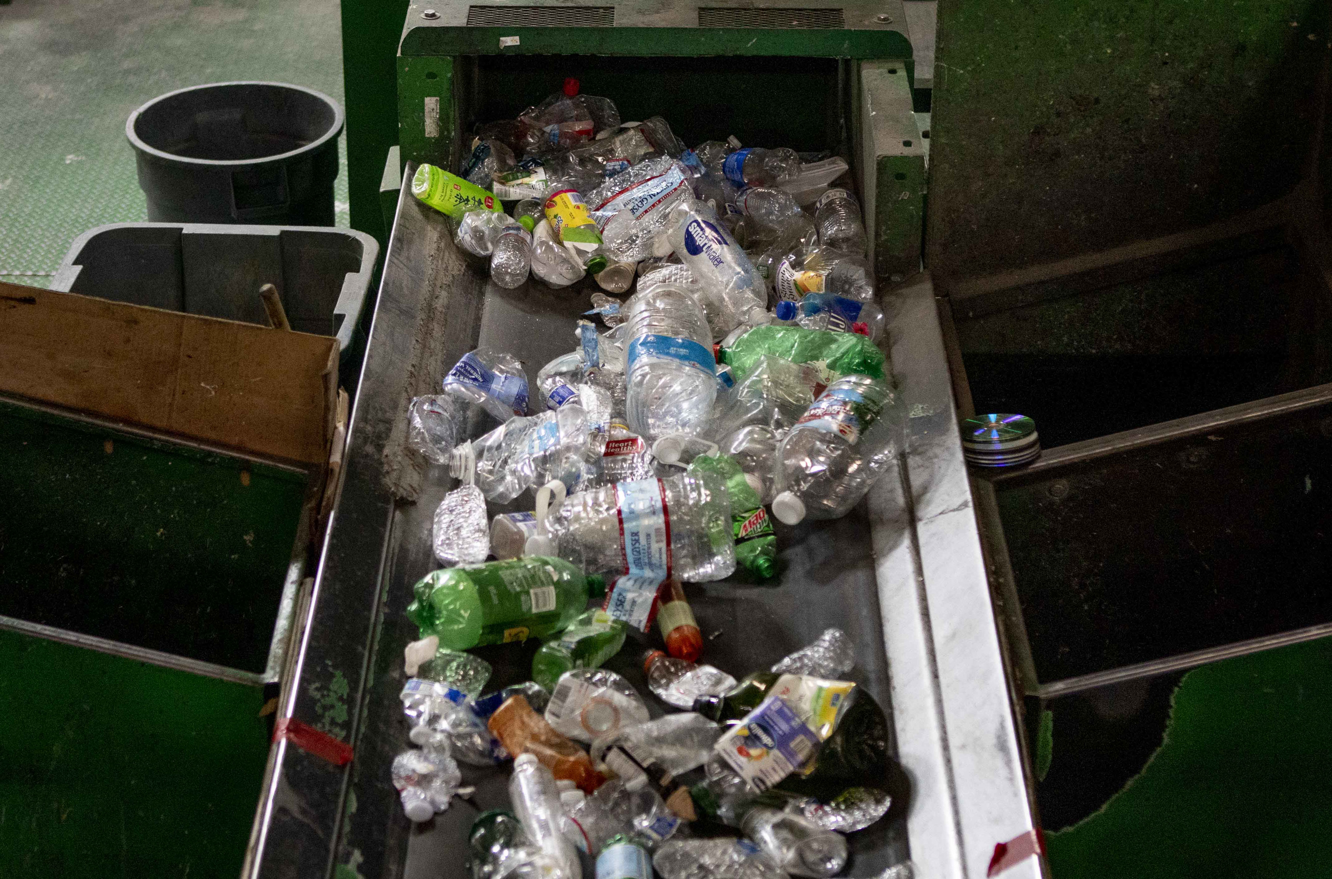 Plastic bottles on a conveyor belt at GreenWaste Recovery's facility in San Jose on July 29, 2019. Photo by Anne Wernikoff for CalMatters.