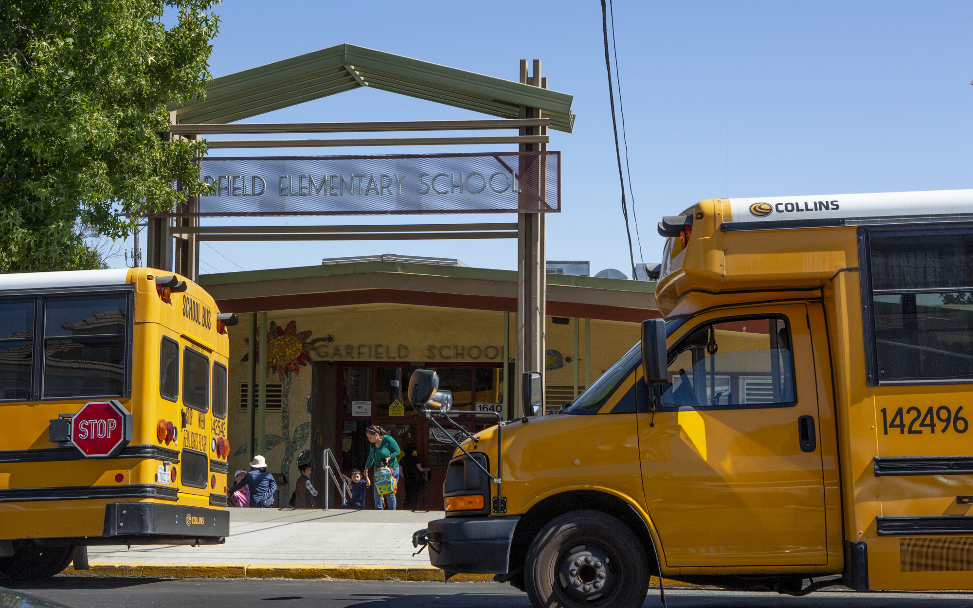 School buses line up outside of Garfield Elementary School in Oakland at the end of the day for pickup on September 6, 2019.