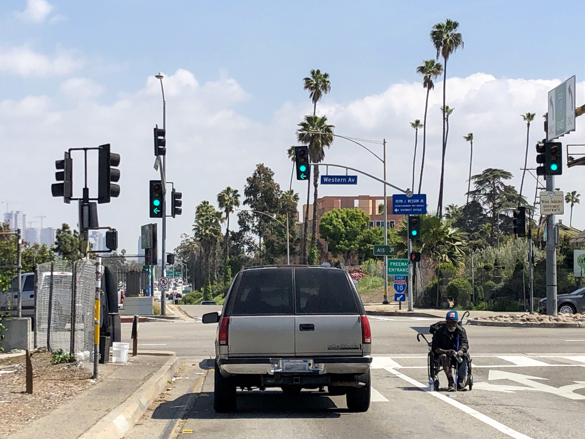 A disabled homeless man begs for change at the Western Avenue exit from the Santa Monica Freeway. Photo by Matt Tinoco/KPCC