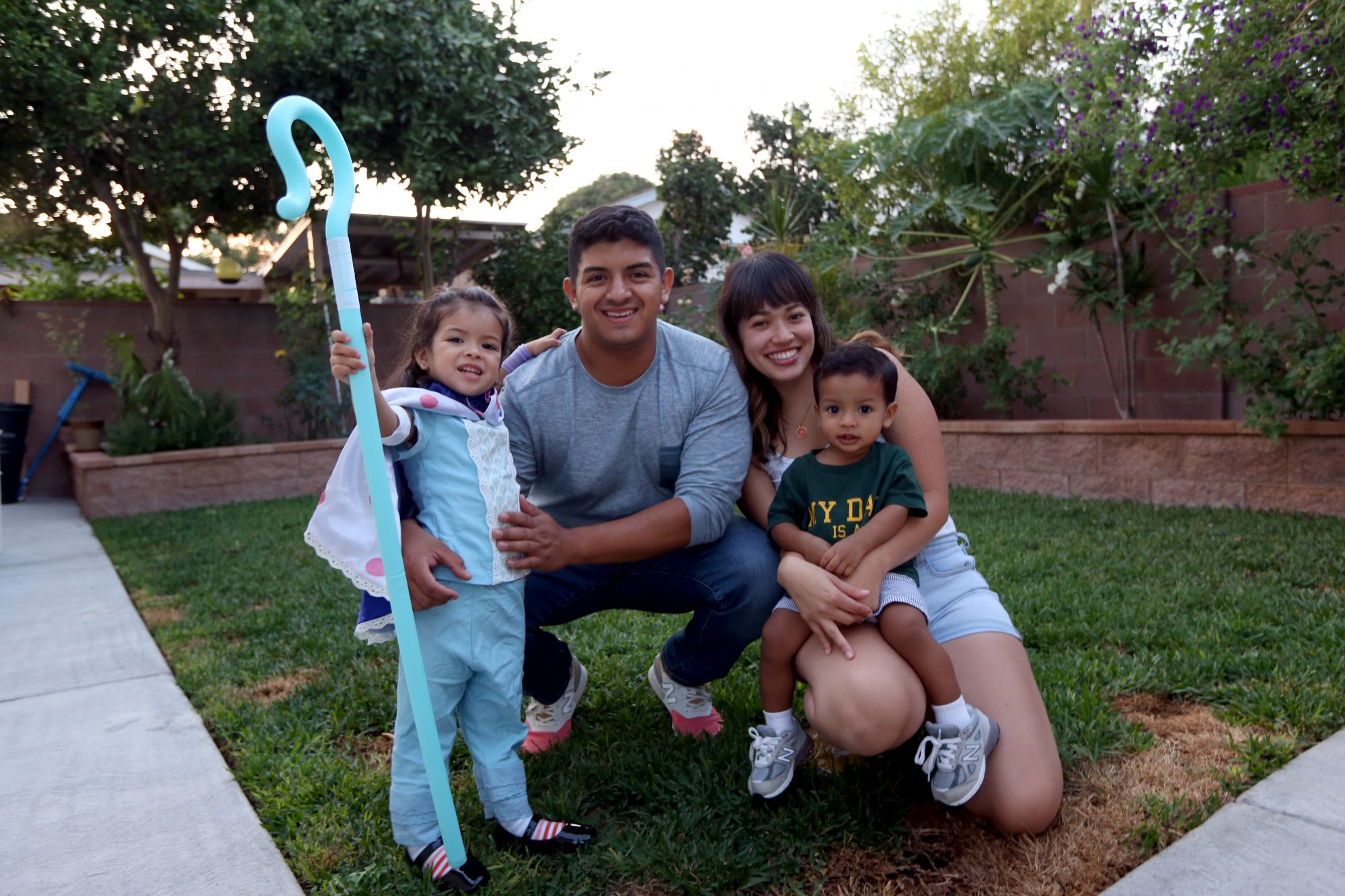 Bianca Rojas and her partner Jose Yat with their children Adeline, 2, and Jasper, 18 months. They are both enrolled full-time as college students, Jose at Cal Poly Pomona and Bianca at Cal State Long Beach and after a long day at school trying to get the kids fed and bathed and ready for bed. Jose says he tries to get his schoolwork done during breaks at school during the day. He is too tired to do any schoolwork after the kids get to bed. Their day starts around 6am as they get ready for school and to drop their kids at daycare on the way to school. They live in the renovated garage behind Jose's parents home in South Gate.