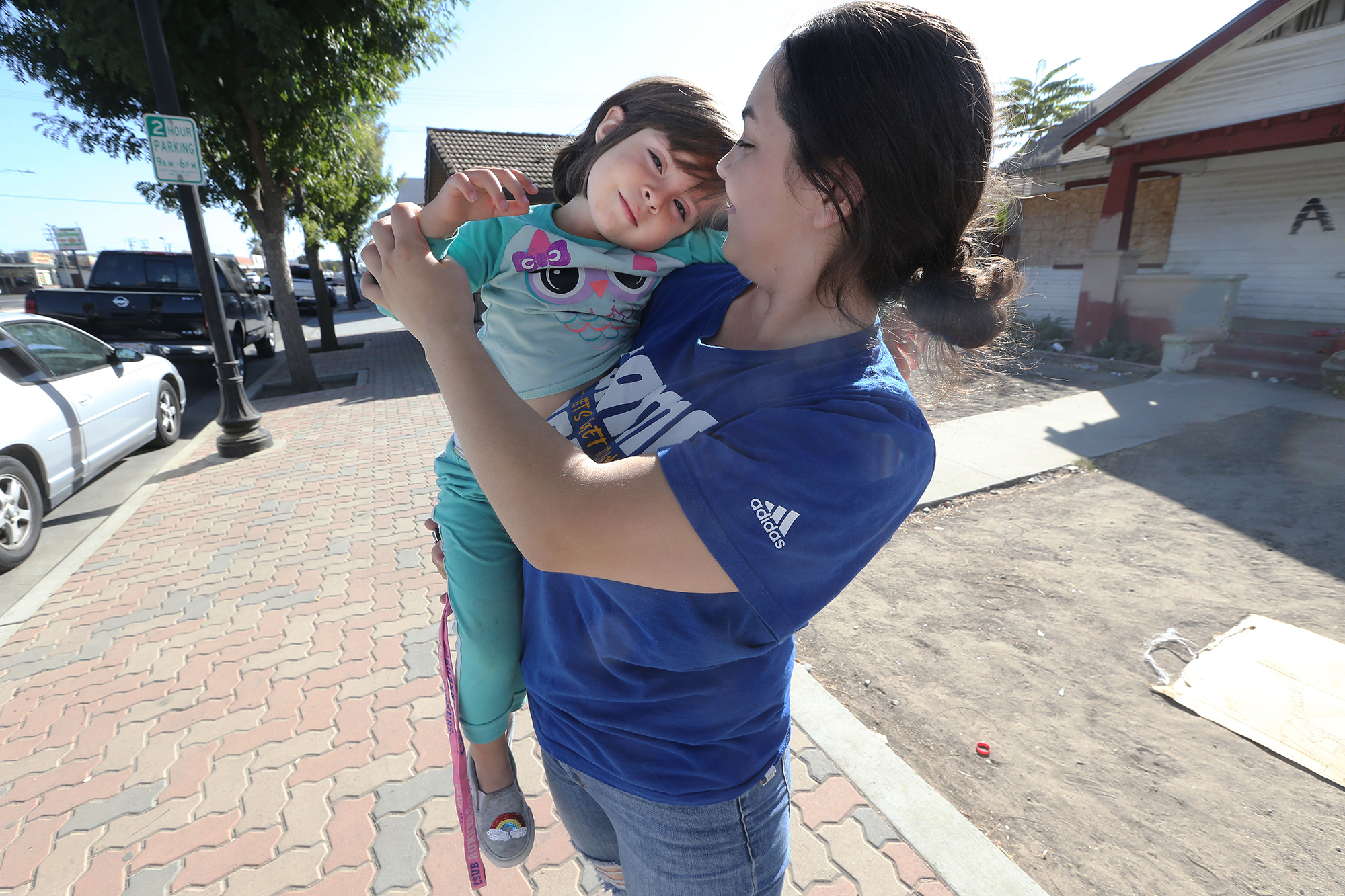 Photo of Diana Shalabi, 20, and her three-year-old, Amina, arrive home after daycare in Delano, California. Photo by Alex Horvath/Bakersfield Californian