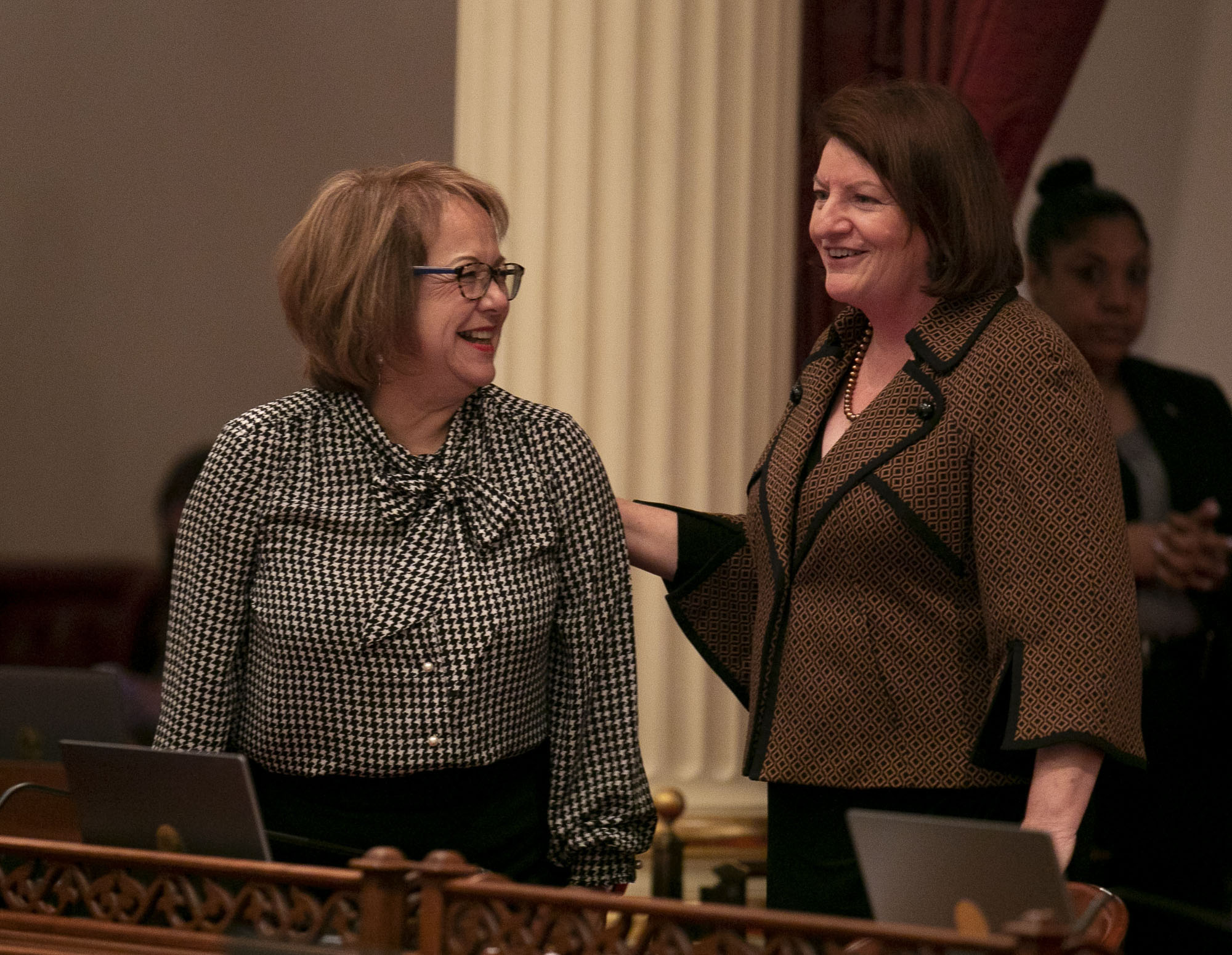 Sen. Maria Elena Durazo,, left, and Senate President pro Tempore Toni Atkins smile on the senate floor on the first day of the 2020 legislative session