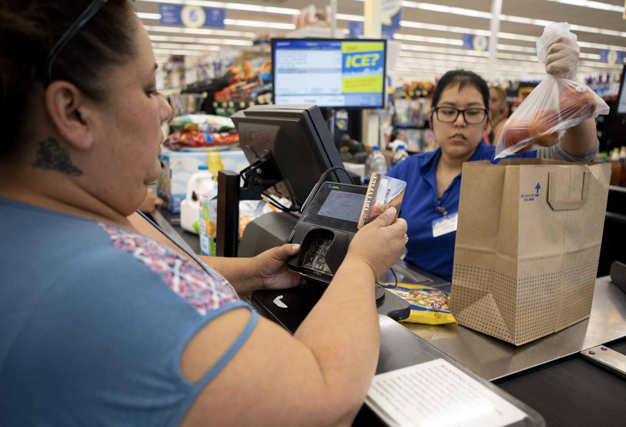 Antoinette Martinez uses CalFresh to pay for her groceries at FoodMaxx