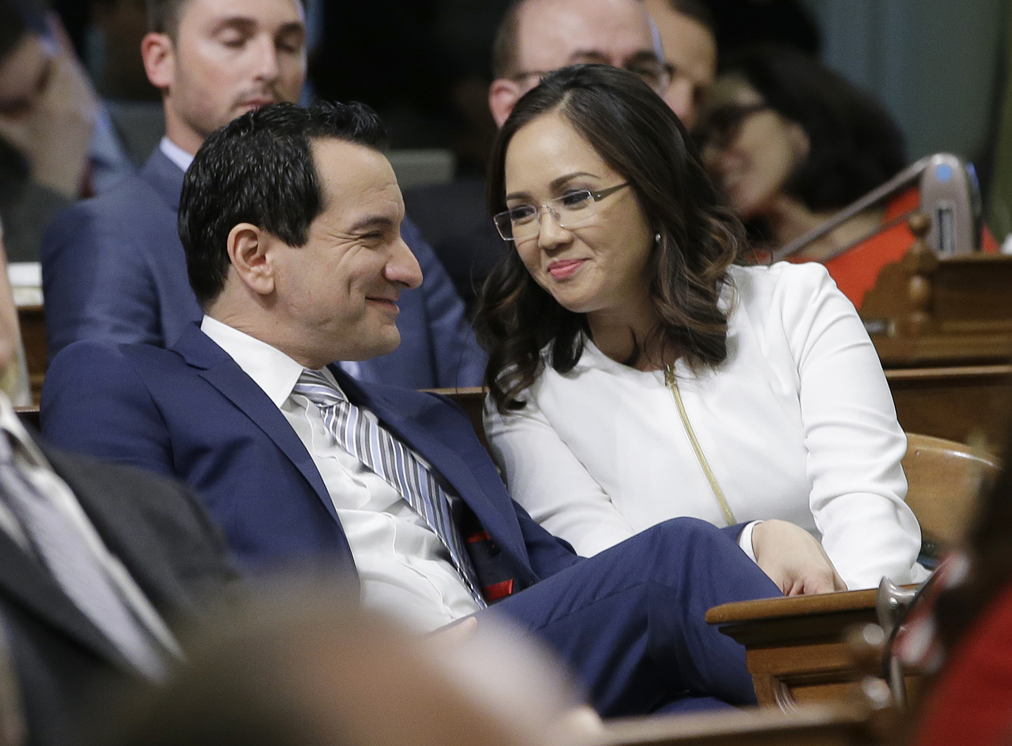Assemblyman Anthony Rendon smiles at his wife, Annie Lam, before he was sworn-in as 70th Speaker of the California Assembly