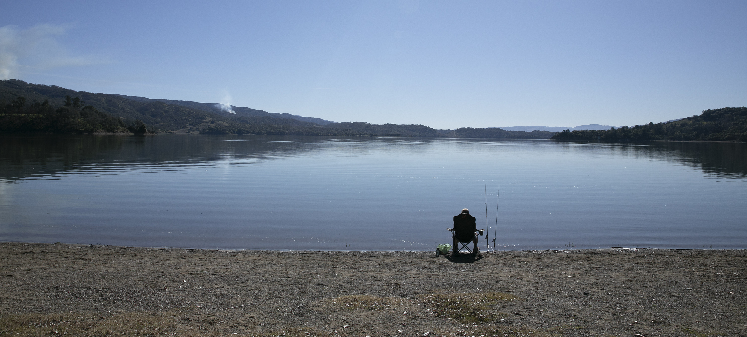 A person fishing at Lake Mendocino on February 11, 2020. Photo by Anne Wernikoff for CalMatters