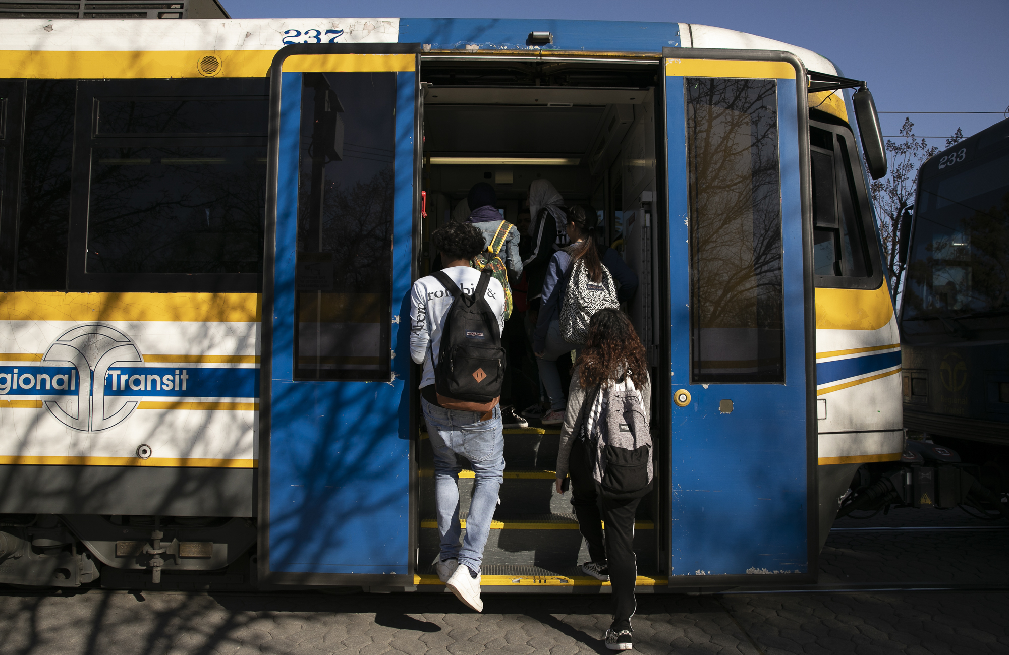 Local high school students catch the light rail at the end of the day in Sacramento. Photo by Anne Wernikoff for CalMatters