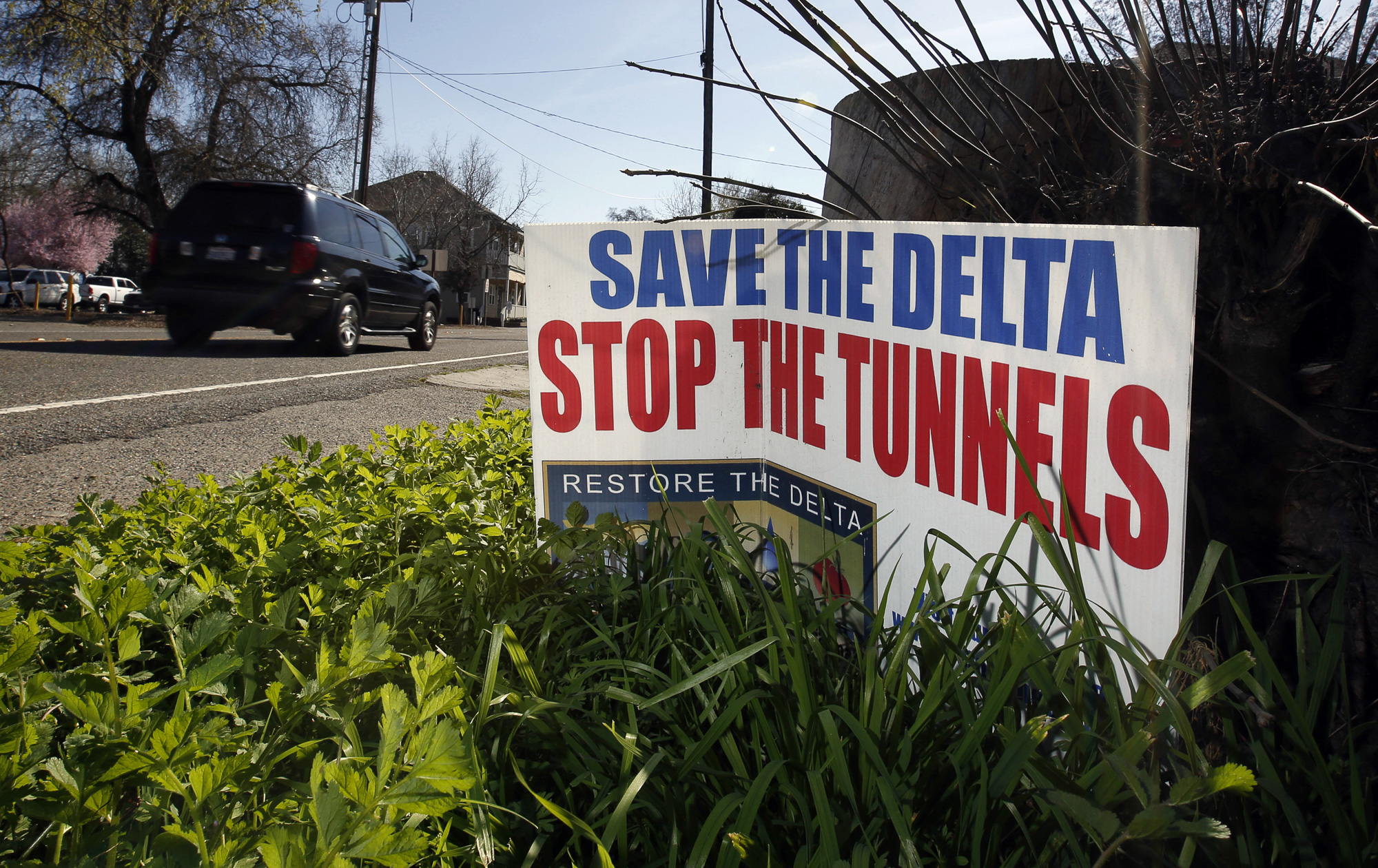 In this Feb. 23, 2016 file photo a sign opposing a proposed plan by Gov. Jerry Brown to build two giant tunnels to ship water through the Sacramento-San Joaquin Delta to Southern California is displayed near Freeport, Calif. Gov. Gavin Newsom officially abandoned his predecessor's plan, Thursday, May 2, 2019, opting instead for just one, smaller tunnel. Photo by Rich Pedroncelli, AP Photo