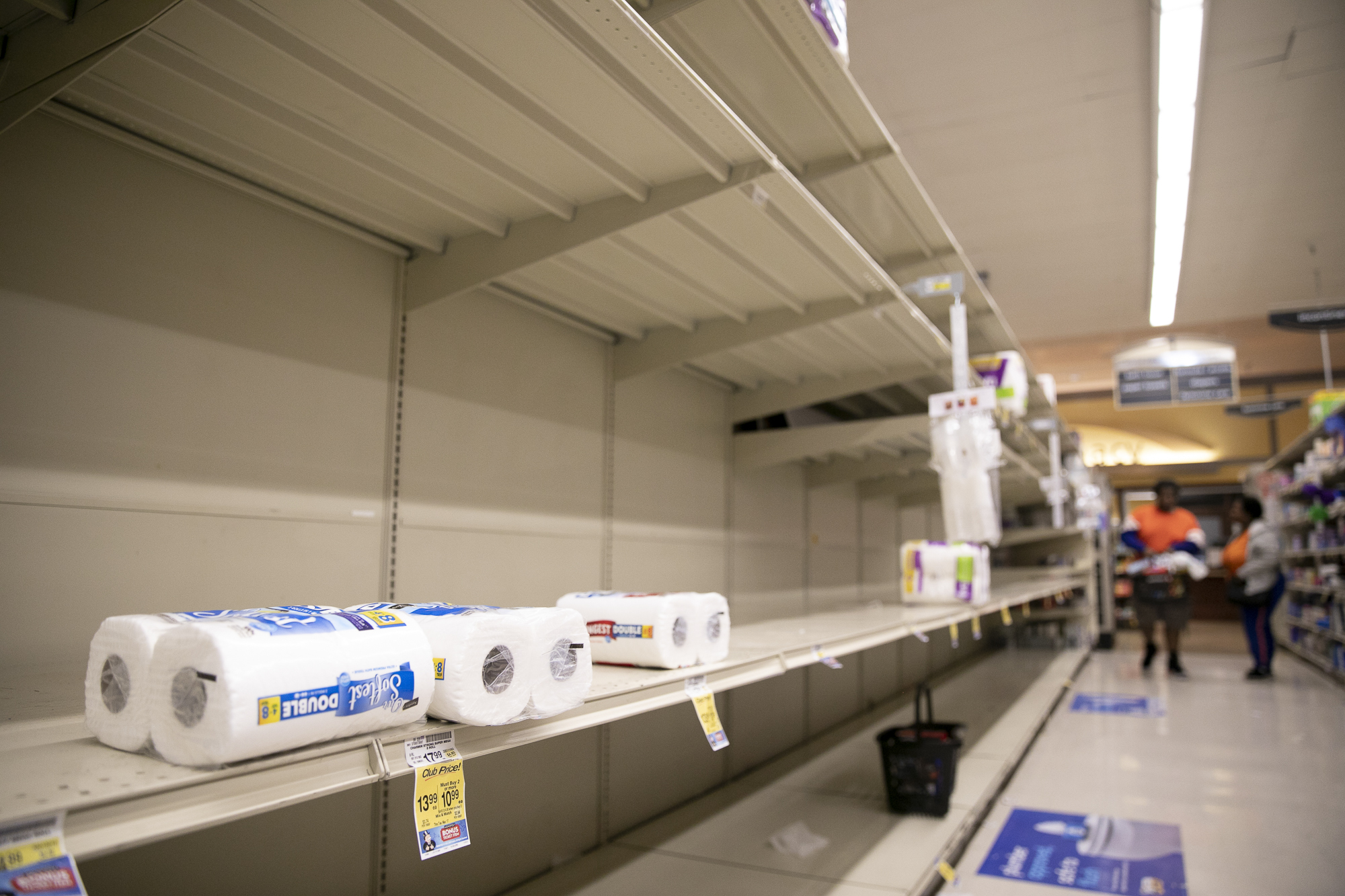 Empty shelves of toilet paper and paper towels at Safeway in the Fillmore neighborhood of San Francisco on March 13, 2020. On Thursday Gov. Gavin Newsom issued an executive order banning events of more than 250 people amid coronavirus concerns. Photo by Anne Wernikoff for CalMatters