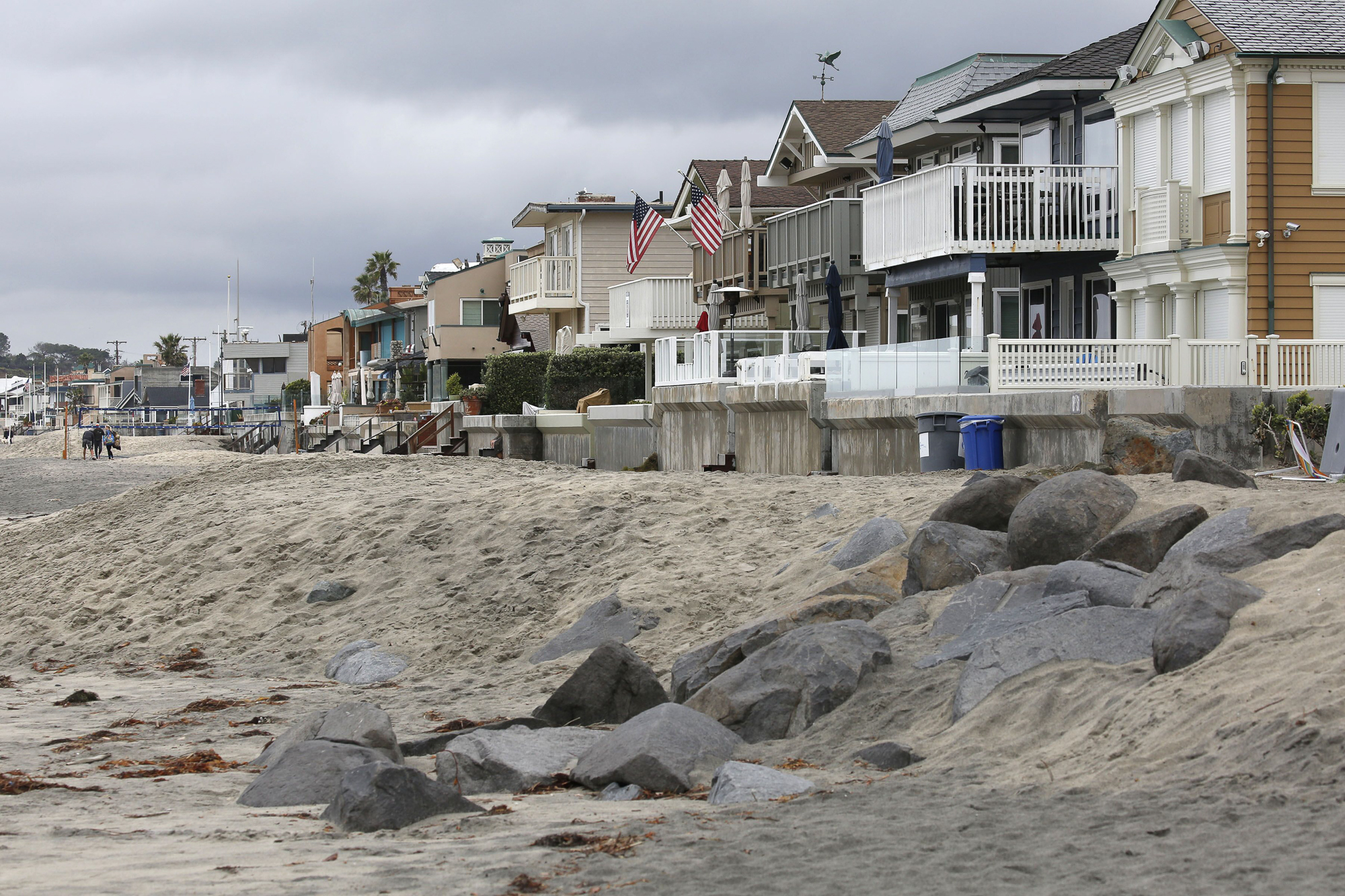 Sand-and-rock berms form a barrier along beachfront homes in Del Mar, California, March 2020. Photo by Peggy Peattie for CalMatters