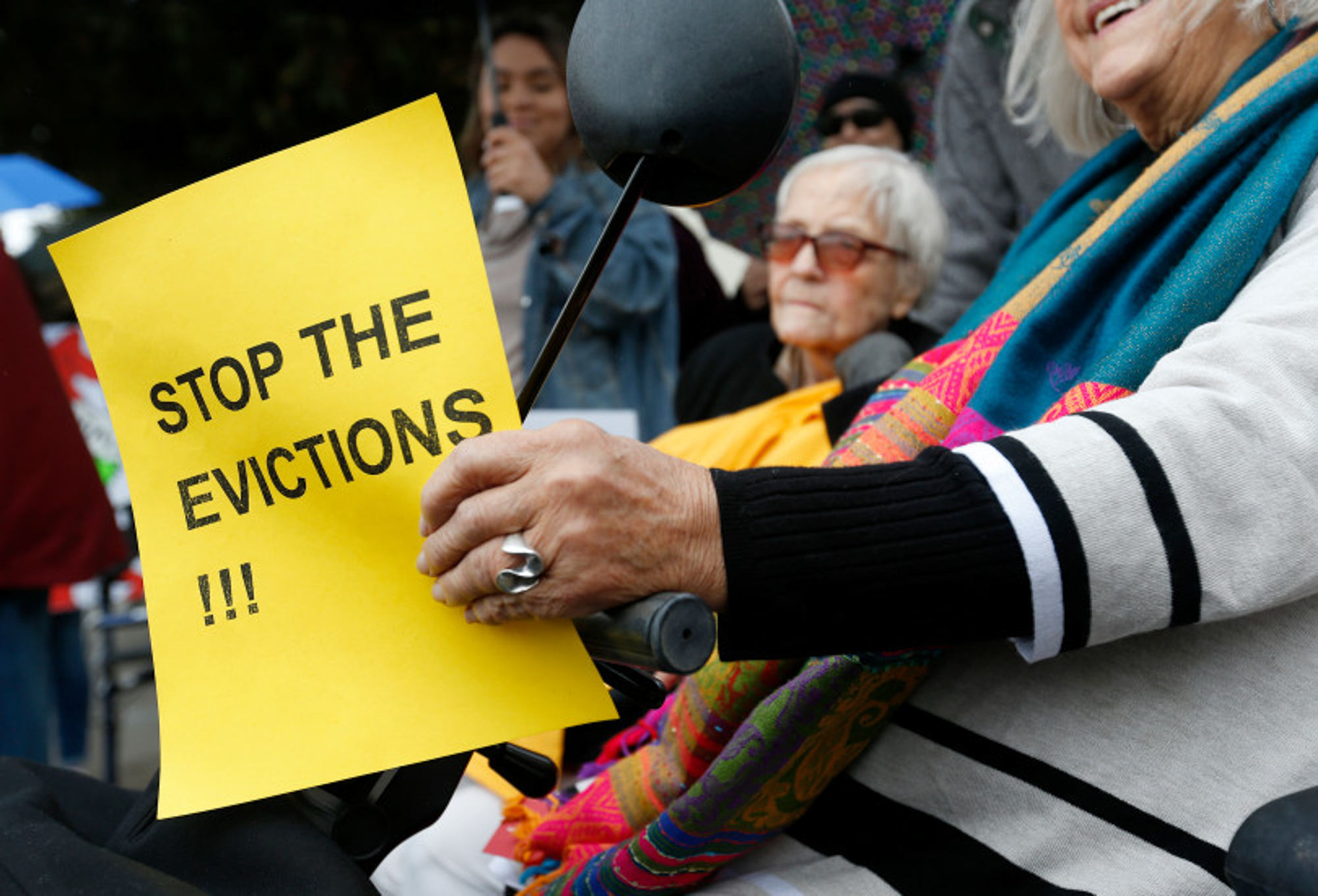 Resident Martha Kapla, right, holds a sign during a rally in front of Brookdale San Pablo assisted living in San Pablo, Calif., on Wednesday, Dec. 18, 2019.
