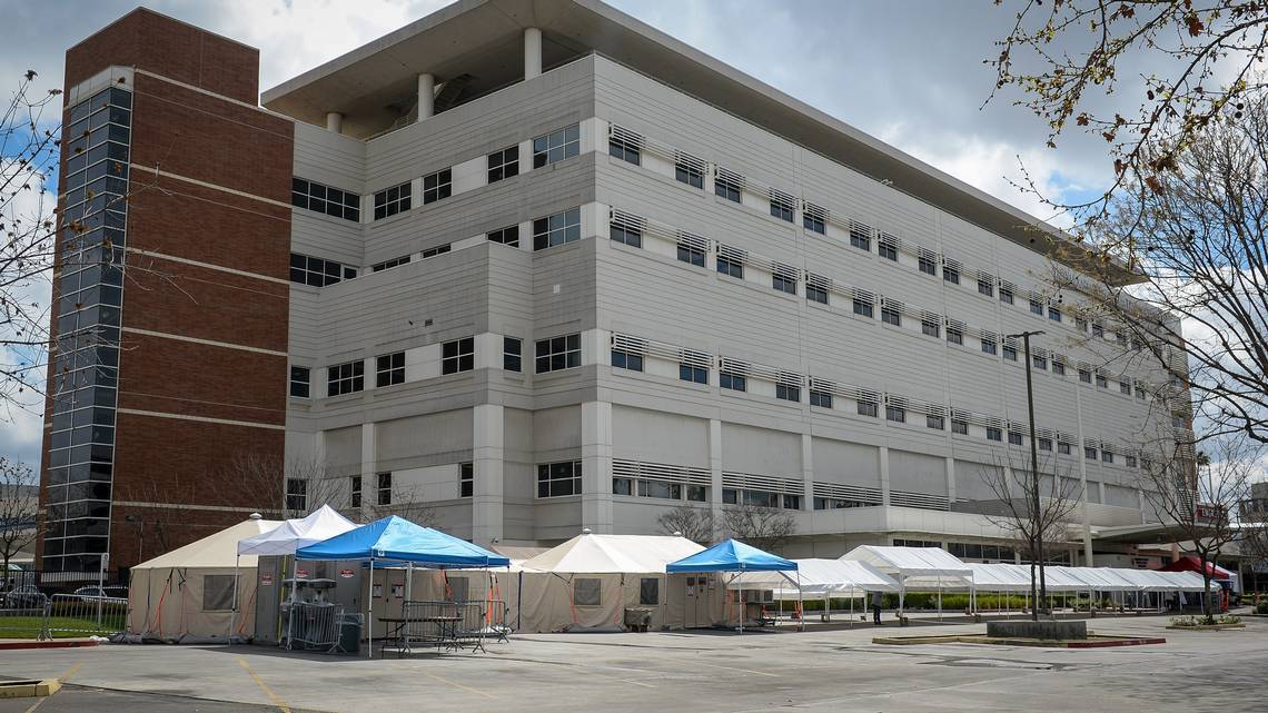 Photo of Emergency tents are set up in the parking lot outside the emergency entrance at Community Regional Medical Center in downtown Fresno where staff is gearing up for expected coronavirus cases