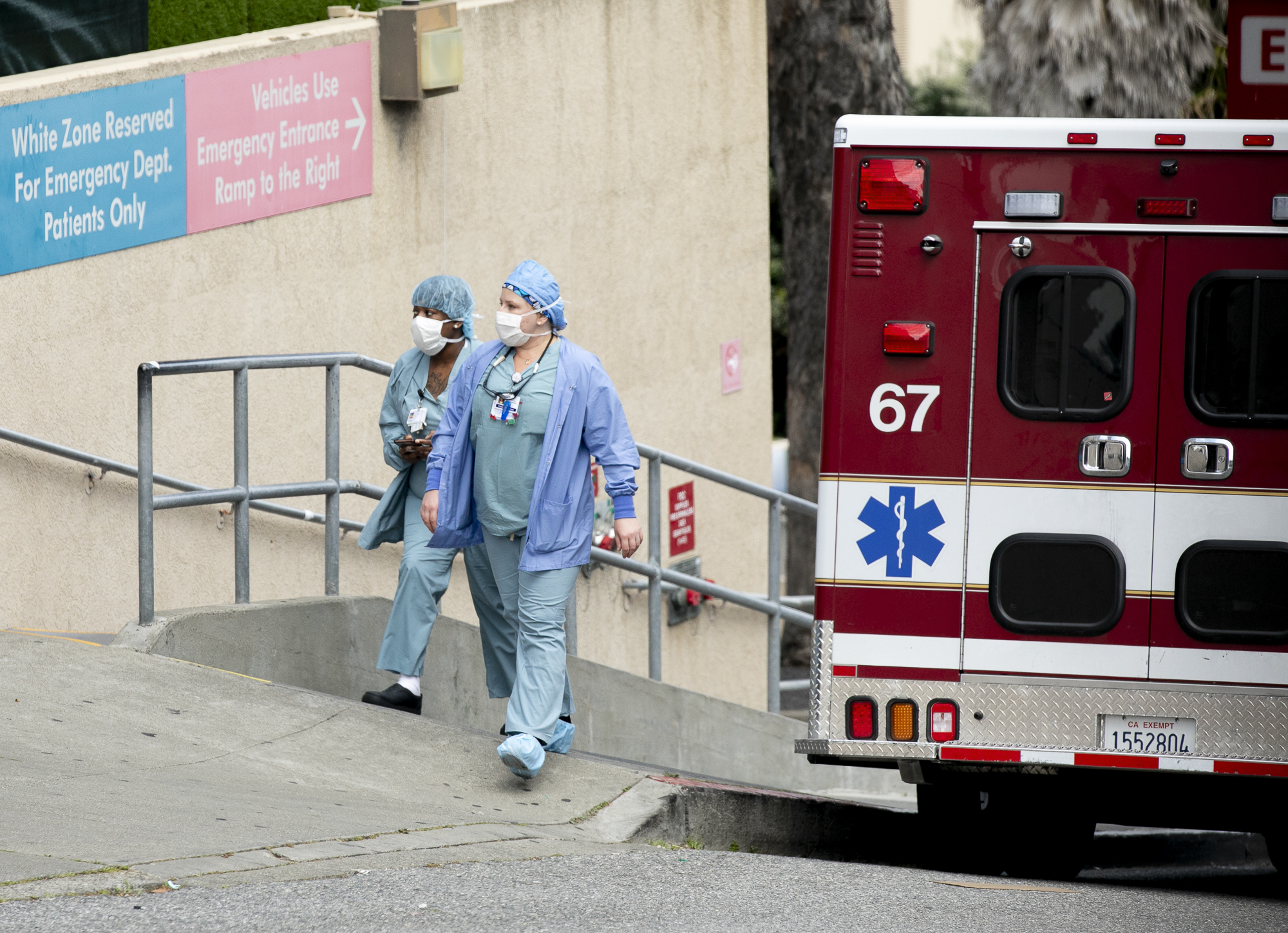 Healthcare workers at a Kaiser hospital in San Francisco on April 9, 2020. Today, Gov. Gavin Newsom announced that the state would make hotel rooms available to care providers in regions with high rates of COVID-19 infections who need to self-isolate. Photo by Anne Wernikoff for CalMatters