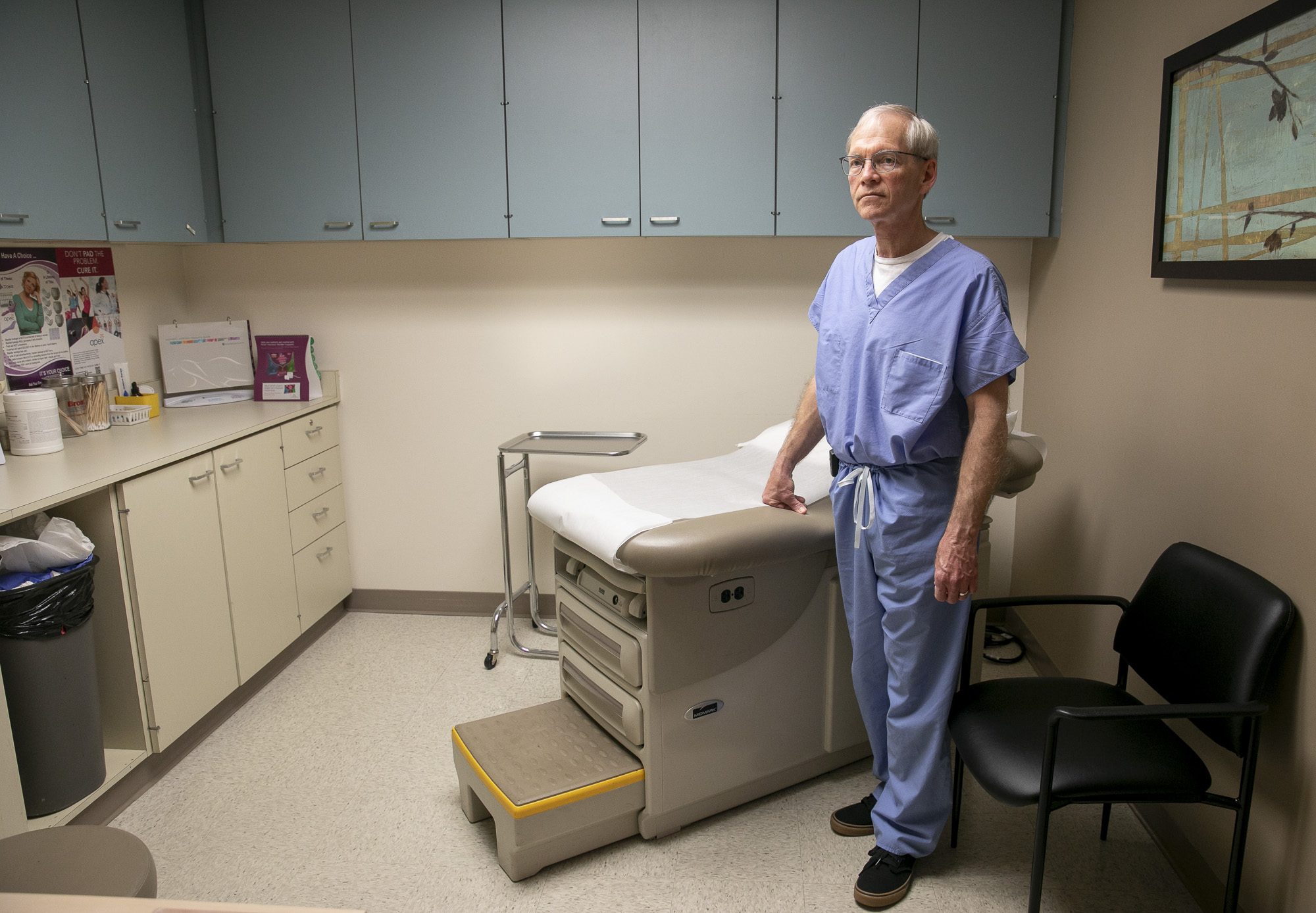 Dr. George Scott in one of five examination rooms in his Manteca clinic. Dr. Scott's private OB/GYN practice is being forced to move to a smaller clinic space after their landlord more than tripled their rent in early March. Photo by Anne Wernikoff for CalMatters