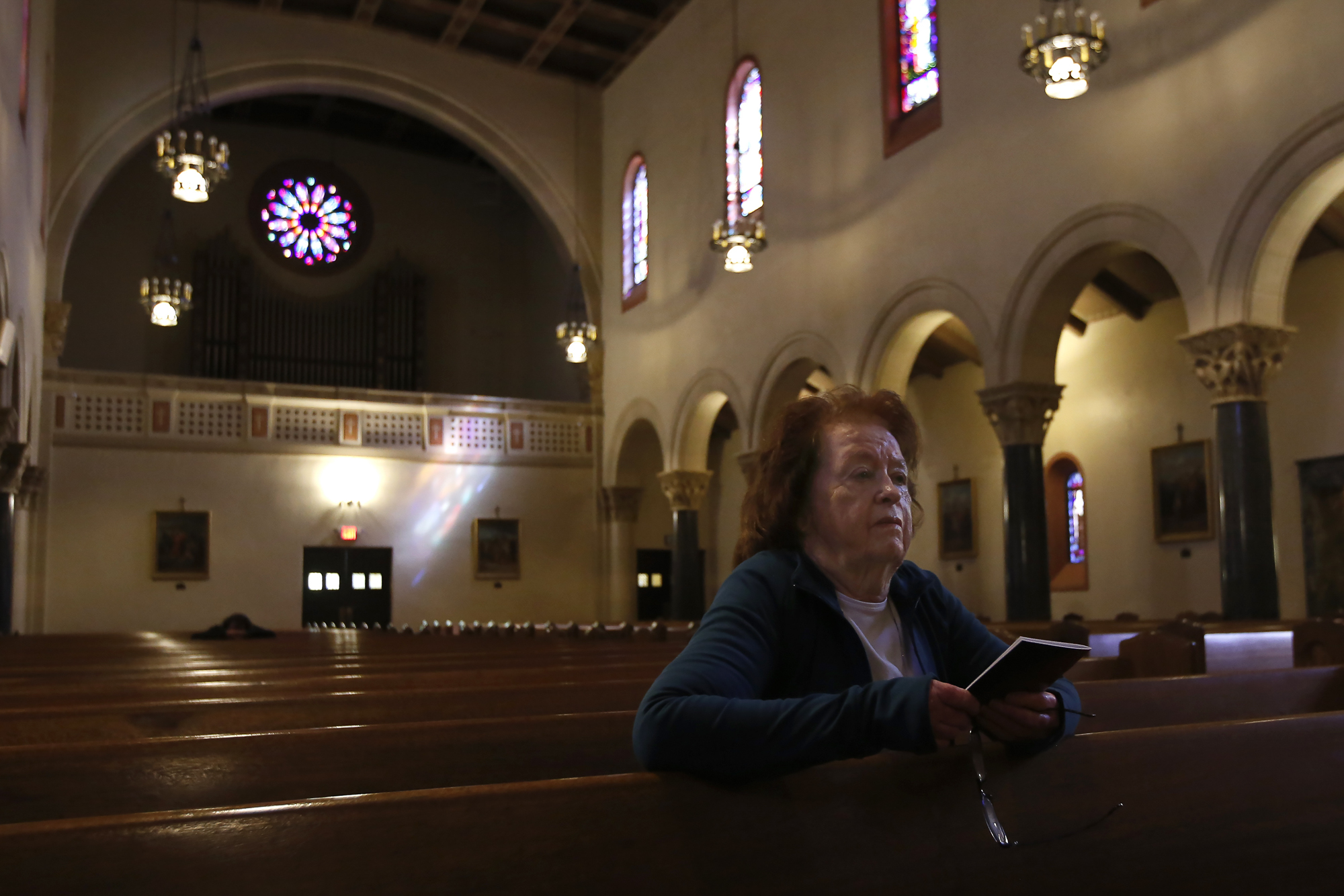 "Joan Knego observes Good Friday in prayer at Sacred Heart Catholic Church in Sacramento, Calif., Friday, April 10, 2020. Due to the coronavirus and California's ""stay-at-home"" order, churches did not hold public Good Friday services. Some provided video services while others opened their doors for personal prayer. Photo by Rich Pedroncelli, AP Photo"