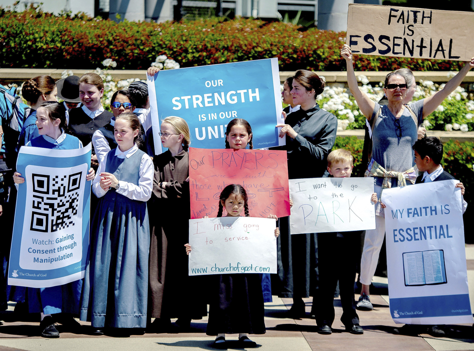 Young members of the Church of God in Rancho Cucamonga demonstrate against California Gov. Gavin Newsom's stay-at-home orders amid the coronavirus outbreak. Newsom has been forced to respond to defiant counties and churches as he slowly lifts restrictions. Photo by Watcher Phomicinda/The Orange County Register via AP