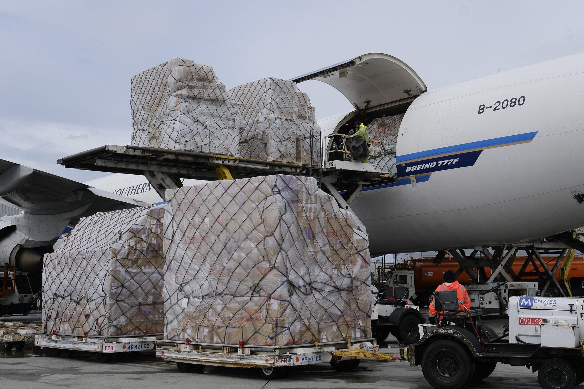 Ground crew at the Los Angeles International airport unload pallets of medical personal protective equipment from a China Southern Cargo plane upon its arrival on April 10, 2020. California has scrambled to cut deals for millions of masks and other gear. AP Photo by Richard Vogel