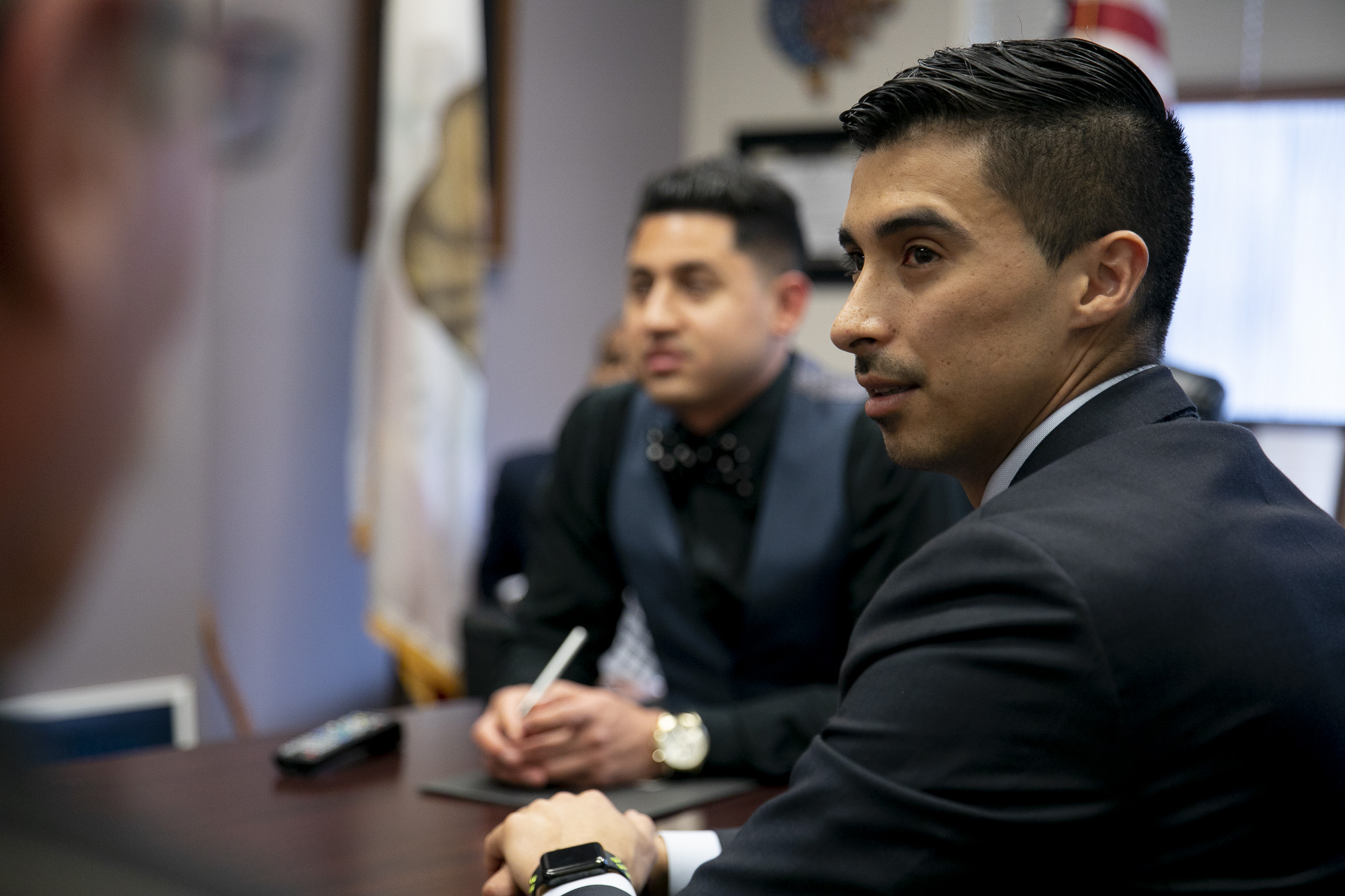 Esteban Nunez speaks with a staffer from Sen. Ben Hueso's office during a meeting with members of a coalition of formerly incarcerated people to advocate for voting rights on March 9, 2020. Photo by Anne Wernikoff for CalMatters