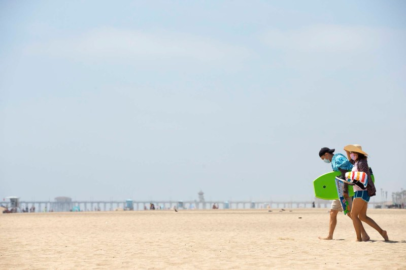 While parking lots remained closed at Huntington Beach State Park due to COVID-19, the beaches opened to the public for limited activities, May 8, 2020. Photos by Lisa Hornak for CalMatters.