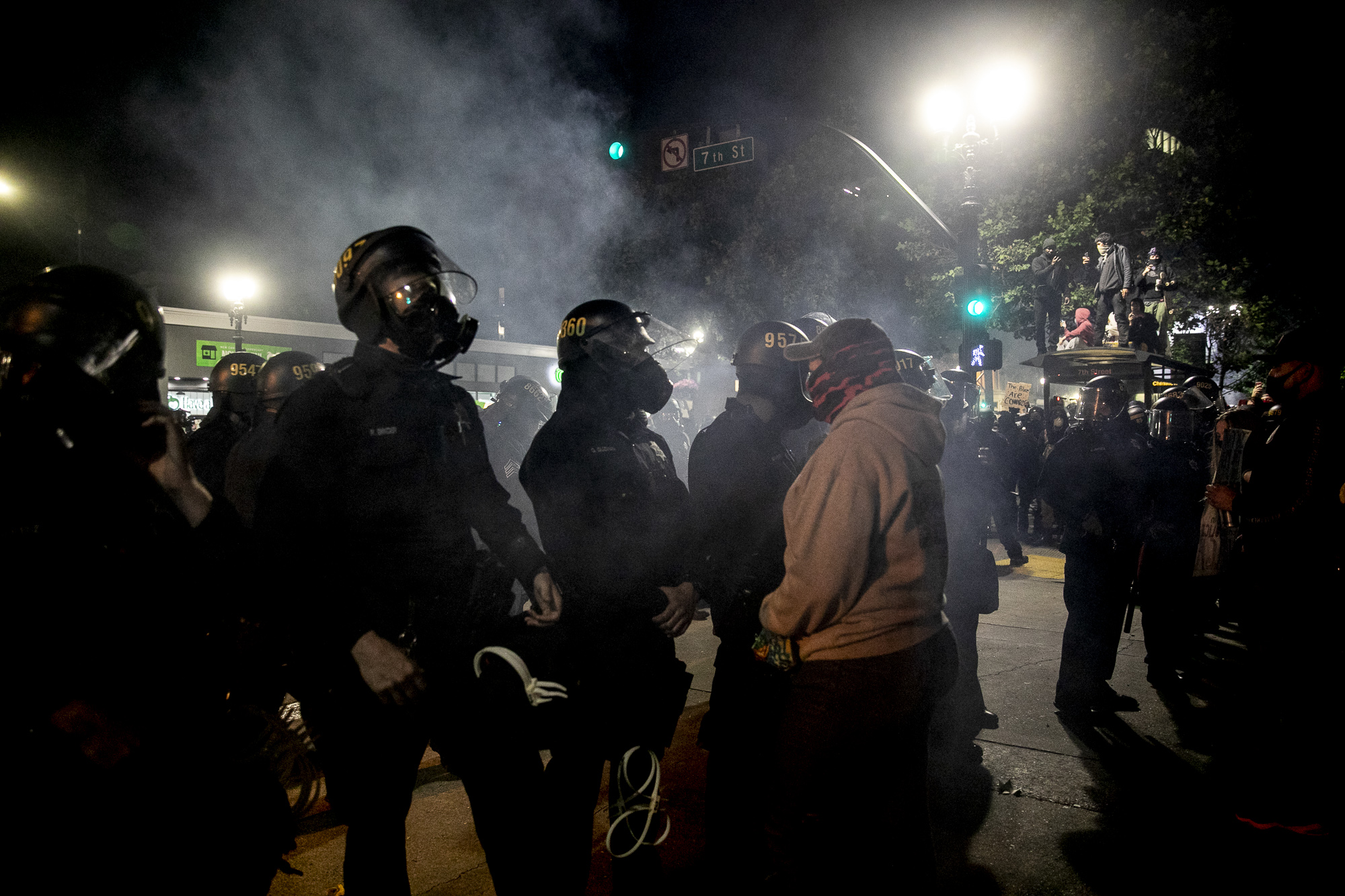 A protester stands off against police during a demonstration May 29, 2020 Downtown Oakland. Thousands took to the streets Friday night in solidarity with protesters in Minneapolis against the killing of George Floyd by Minneapolis police earlier this week. Photo by Anne Wernikoff for CalMatters