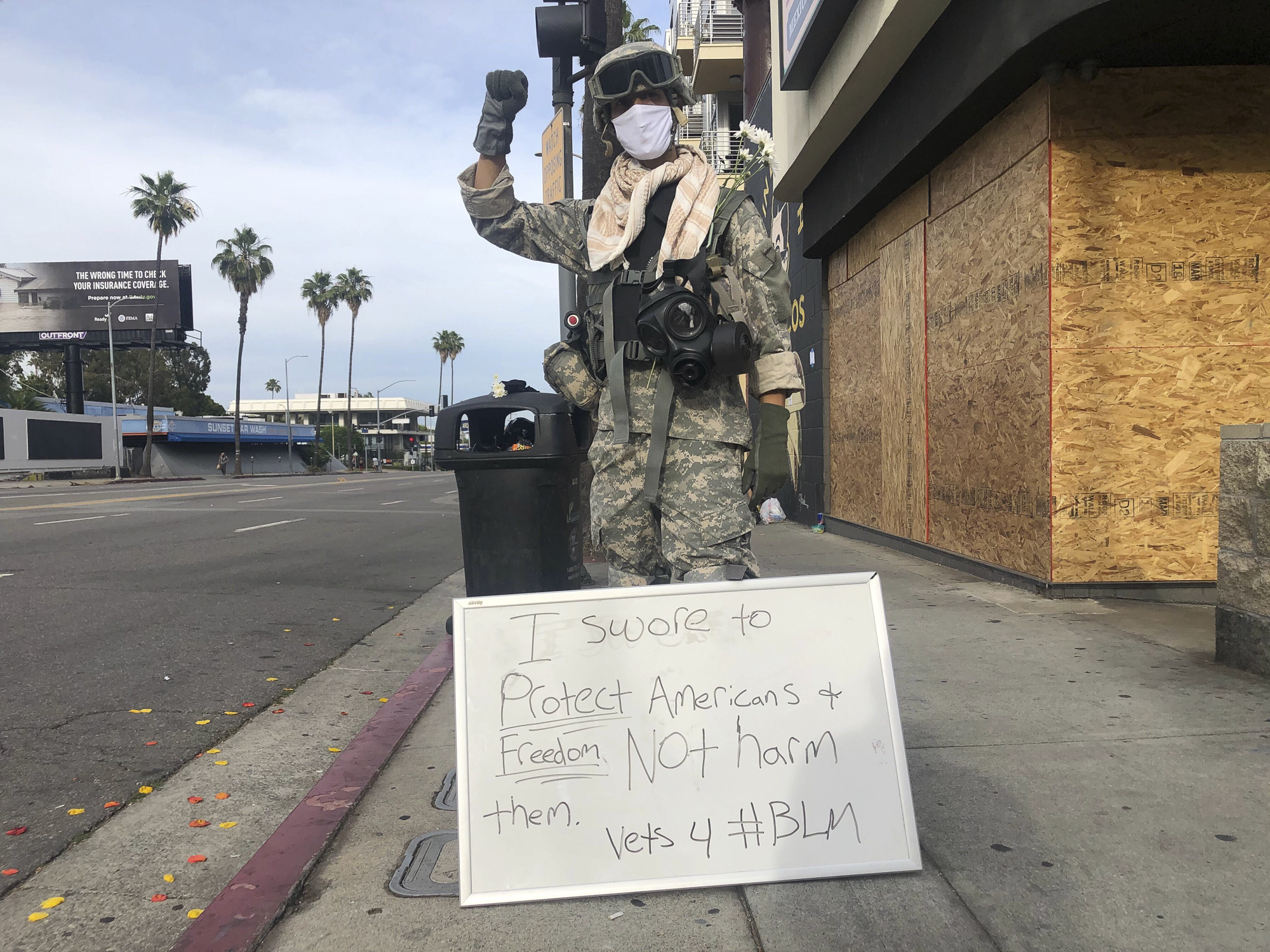 Nathaniel Johnson, 30, a former combat engineer wears his U.S. Army uniform to a protest in Hollywood on June 1, 2020. Photo by Nigel Duara for CalMatters