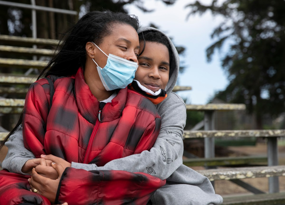 Betty Hunter and her son, Angel, 13, at Crocker Amazon Park in San Francisco on June 26, 2020. Hunter says that she and her son are very close and share a love of anime. Photo by Anne Wernikoff for CalMatters