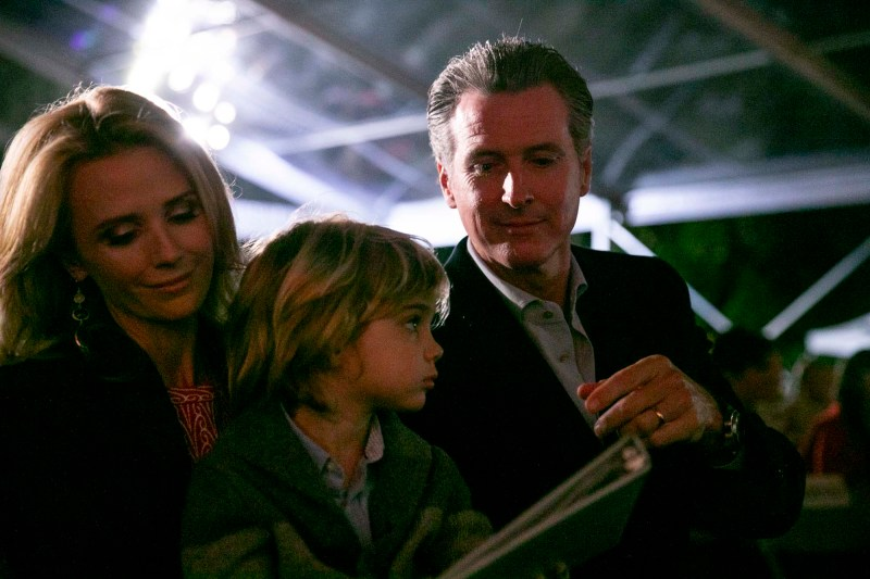 Gov. Gavin Newsom with first partner, Jennifer Siebel Newsom, and their youngest son, Dutch, during the annual Christmas tree lighting at the Capitol on December 15, 2019. Photo by Anne Wernikoff for CalMatters
